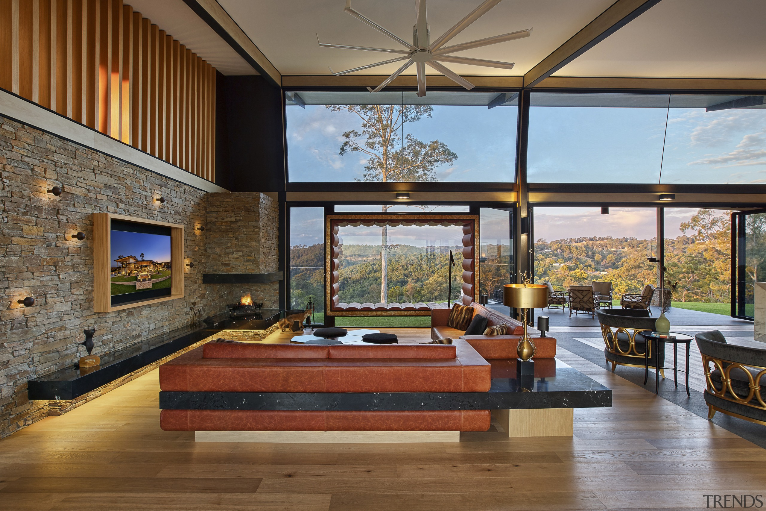 In this luxury lodge, rustic cladding finishes such architecture, ceiling, daylighting, estate, house, interior design, living room, real estate, brown