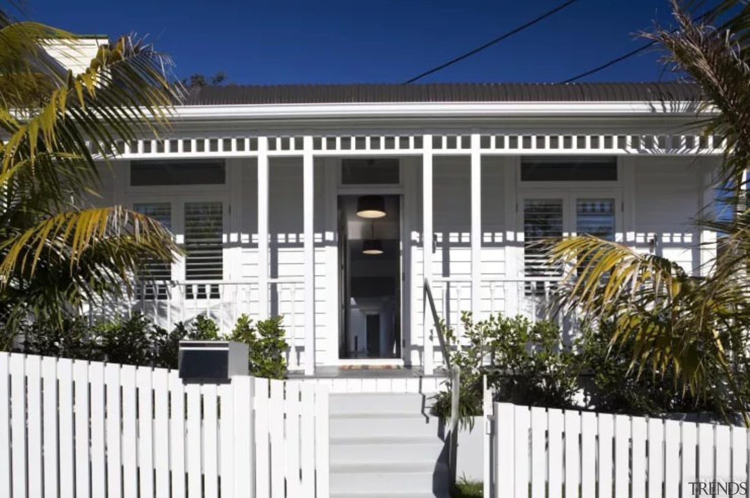 See the home here - An example of building, cottage, estate, facade, fence, home, house, picket fence, property, real estate, residential area, white