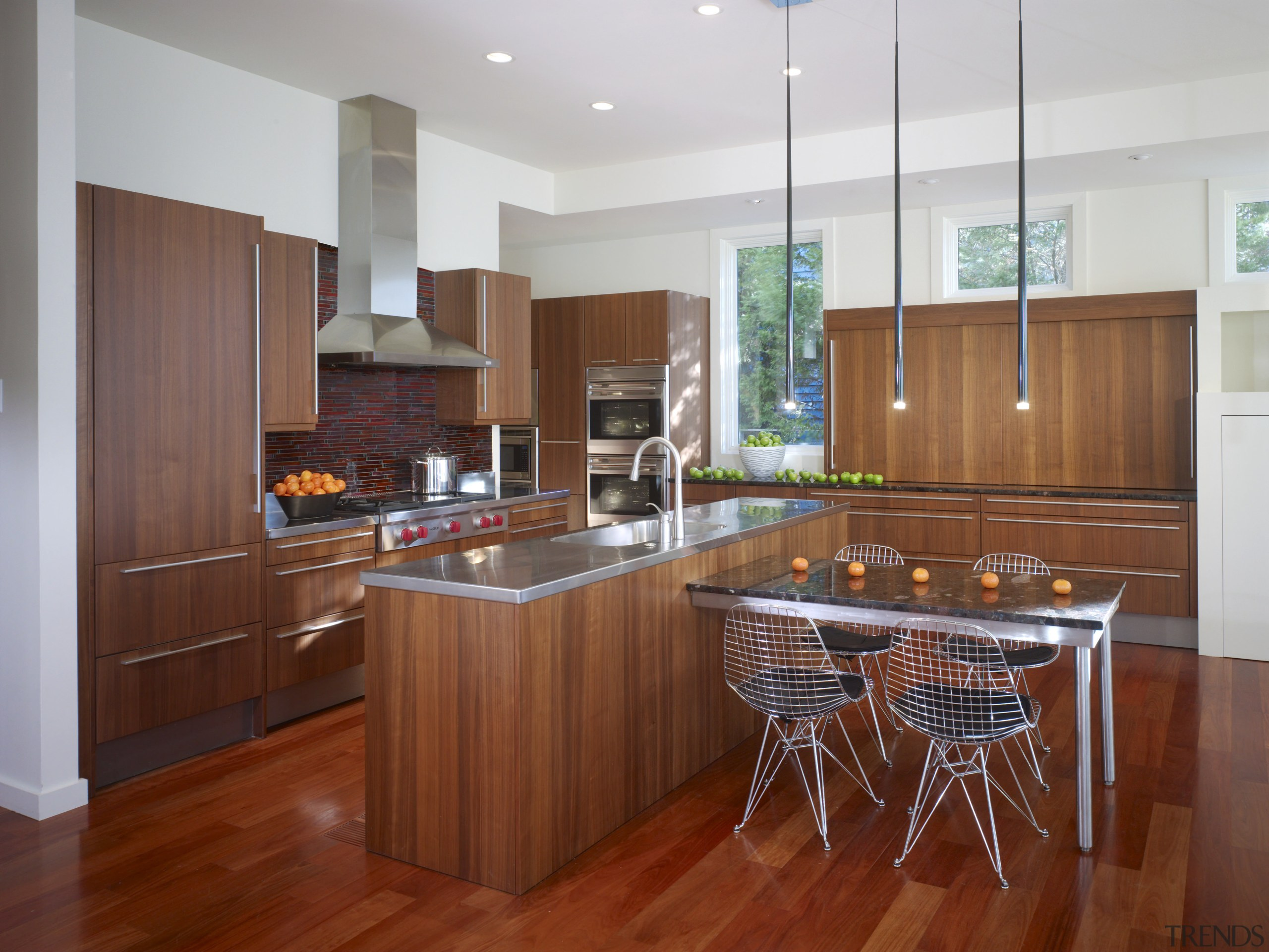 View of a kitchen which combines commerical touches cabinetry, countertop, cuisine classique, floor, flooring, hardwood, interior design, kitchen, laminate flooring, real estate, room, wood, wood flooring, gray, red, brown