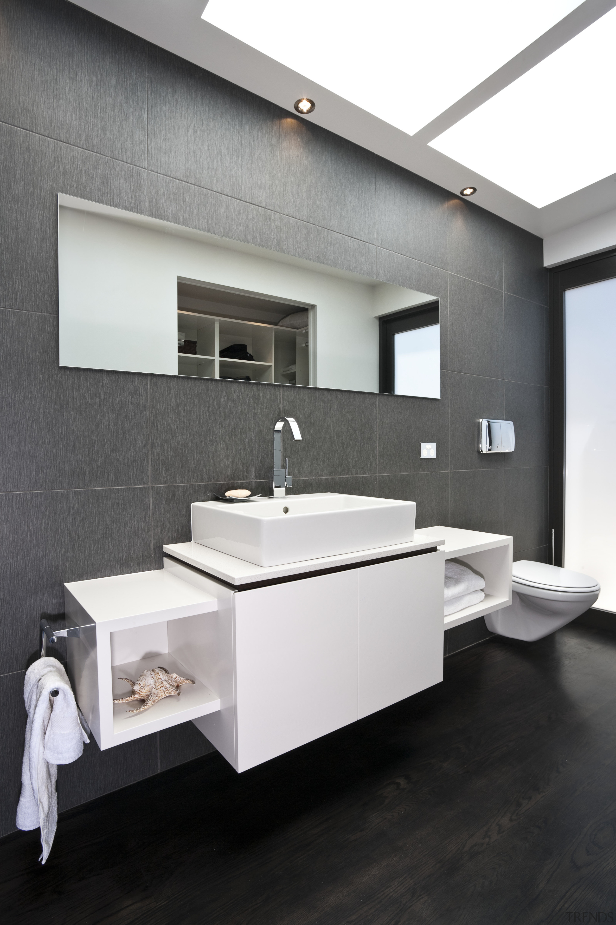 View of the bathroom with black wall tiles bathroom, floor, flooring, interior design, product design, sink, tap, white, black, gray