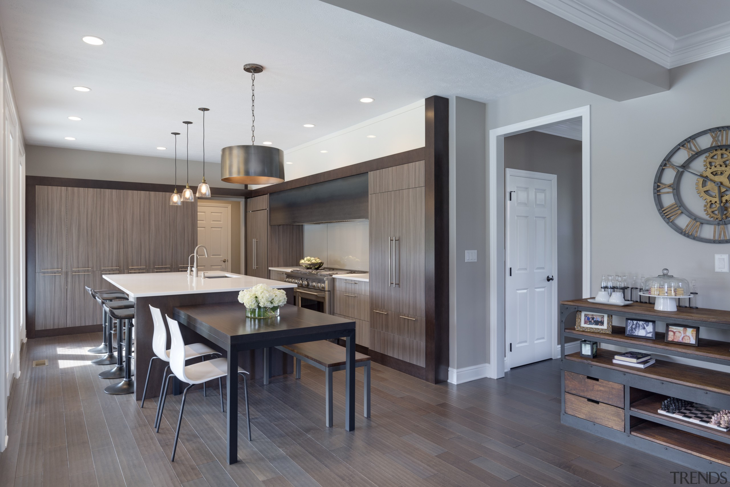 This wood-look kitchen works well with its greater cabinetry, countertop, cuisine classique, floor, flooring, hardwood, interior design, kitchen, laminate flooring, real estate, room, wood flooring, gray