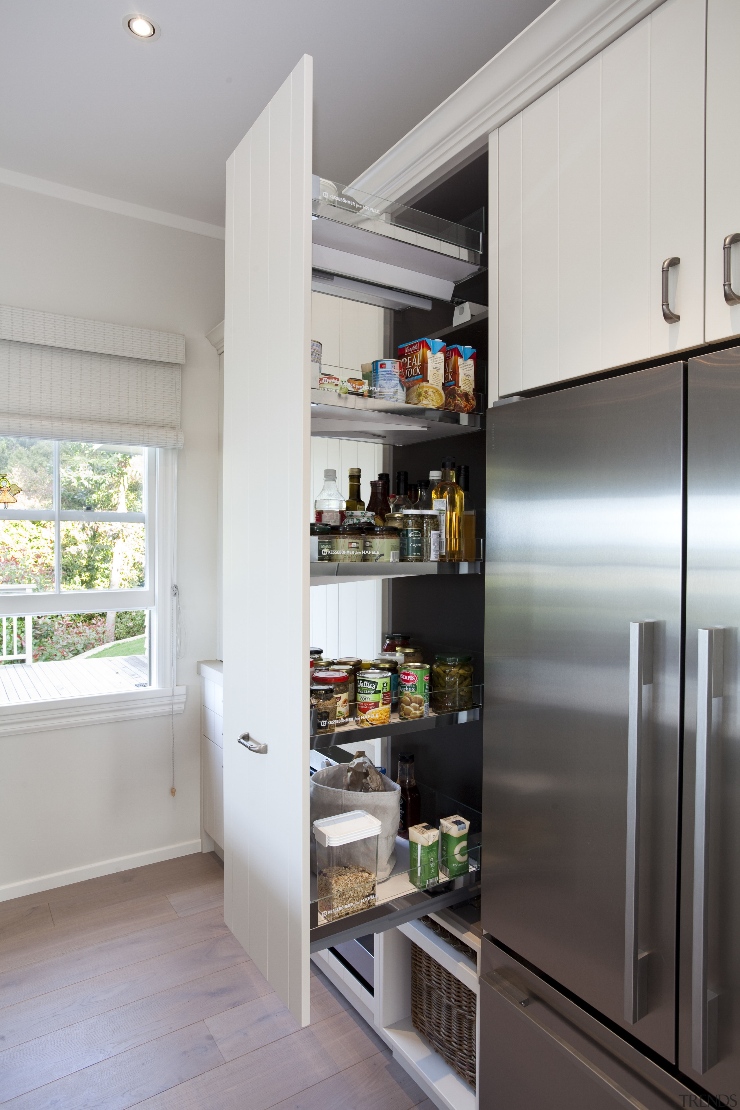 A close up view of the kitchen cabinetry cabinetry, countertop, home, home appliance, interior design, kitchen, refrigerator, shelf, gray