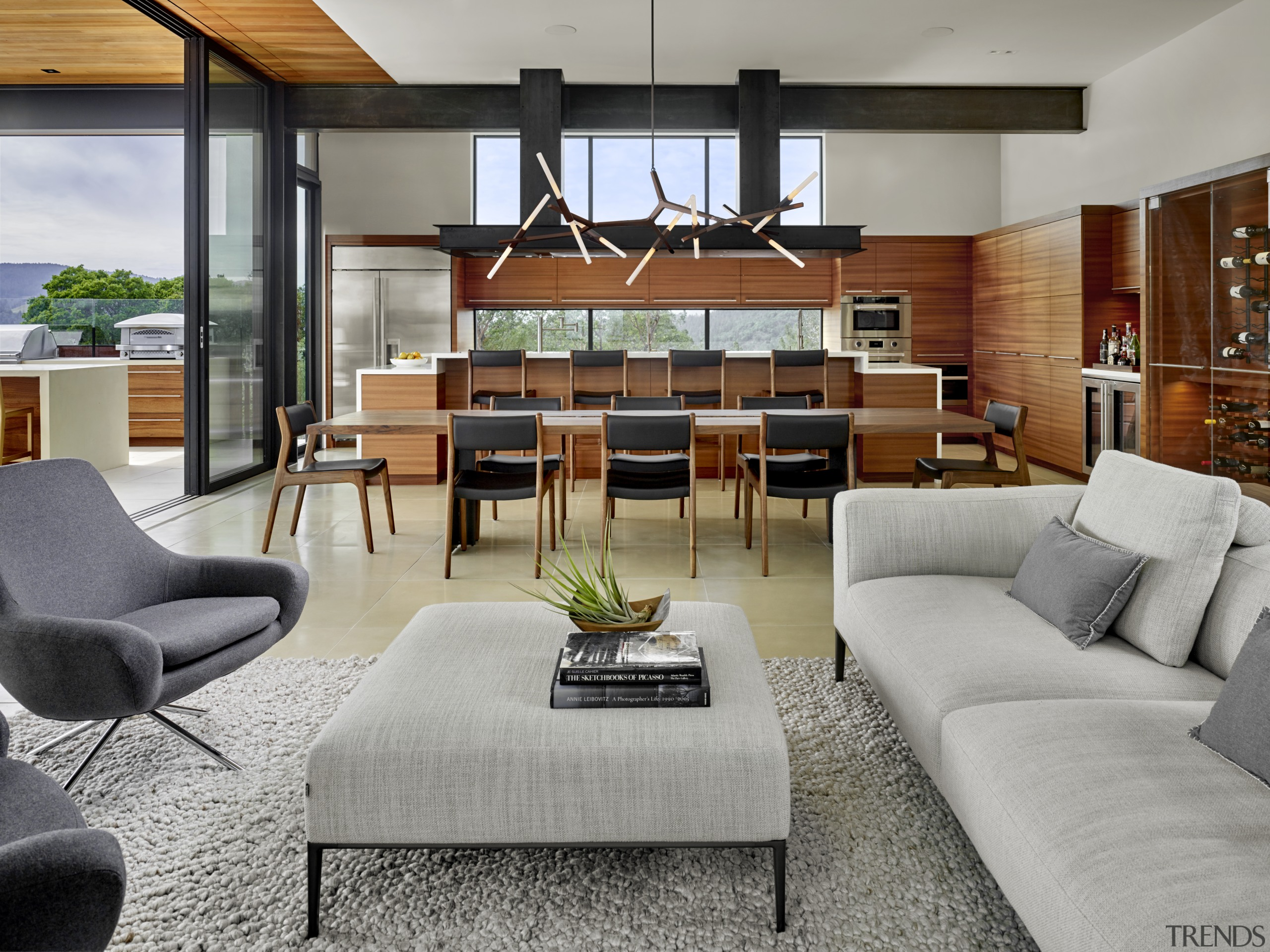 Two substantial blackened steel beams provide interior structural architecture, coffee table, couch, floor, flooring, furniture, hardwood, home, house, interior design, lighting, living room, table, dining, de Vito Architecture + construction