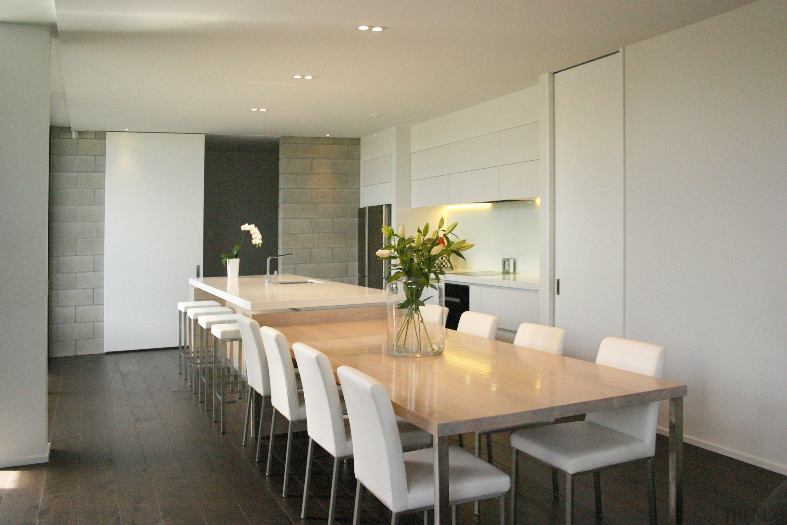 TIDA New Zealand Kitchens – proudly brought to dining room, floor, flooring, interior design, property, real estate, room, table, gray