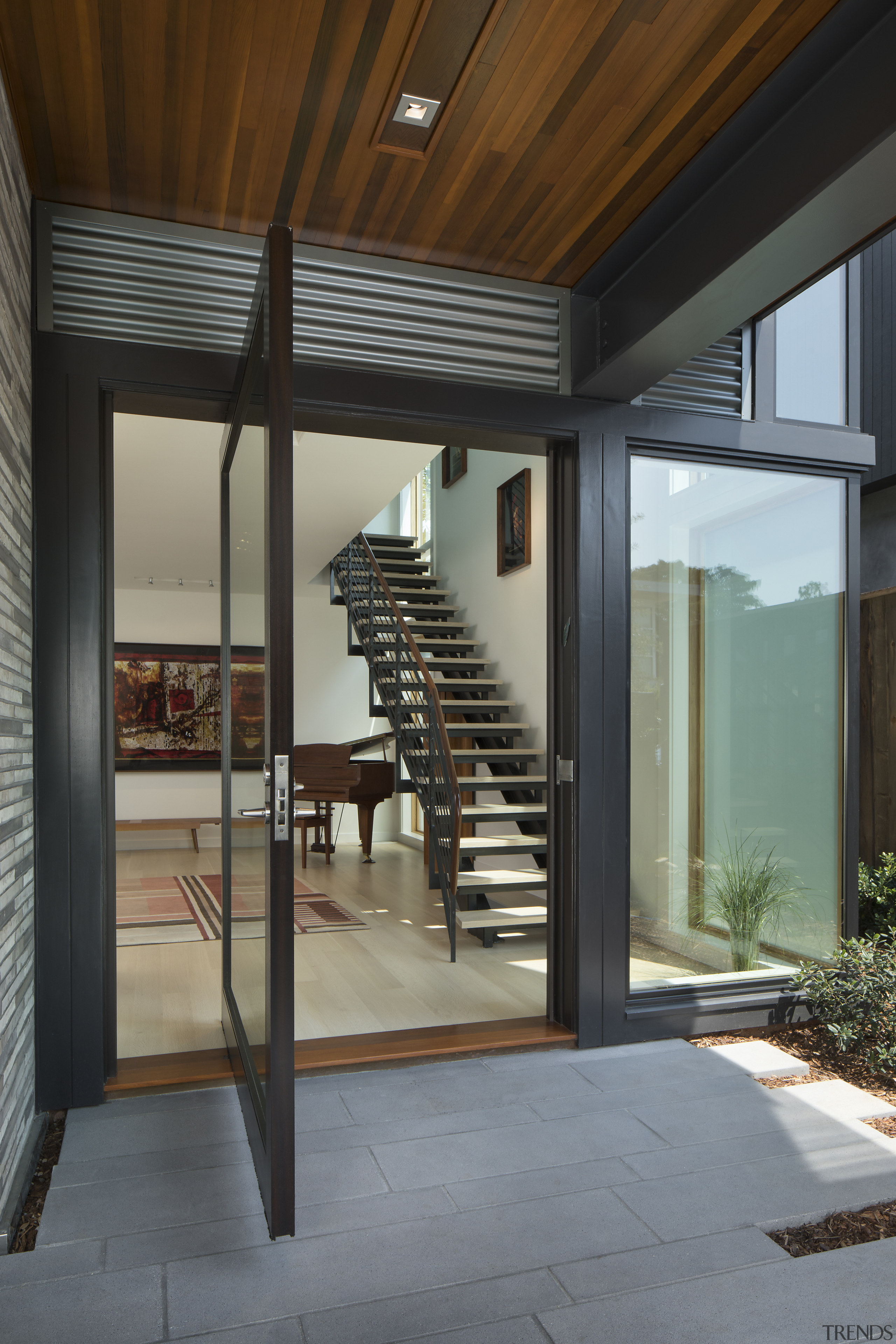 Custom Finne design elements include the spare steel architecture, door, house, interior design, window, gray, black