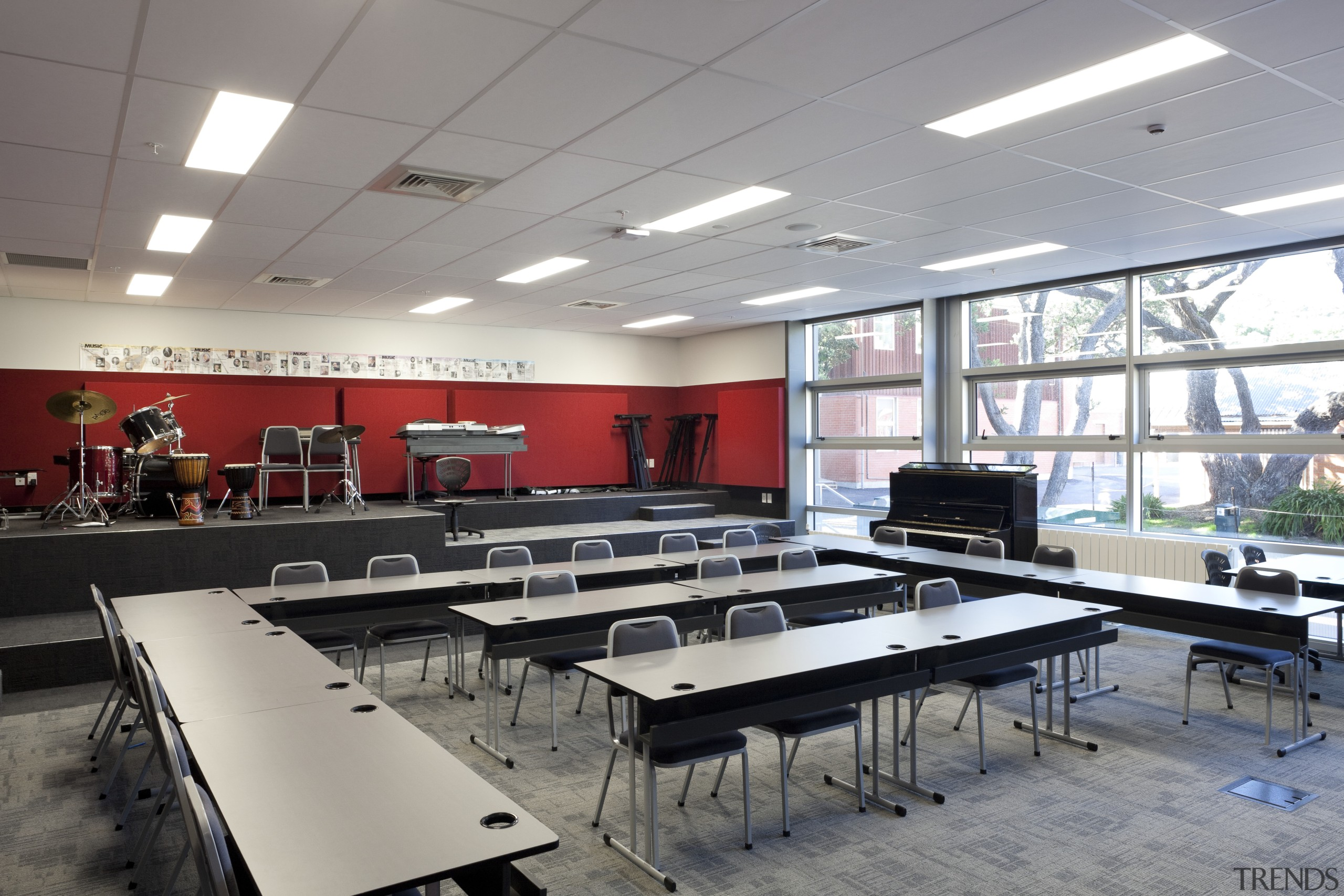 View of classroom with dark furniture and red cafeteria, classroom, conference hall, institution, interior design, room, table, gray