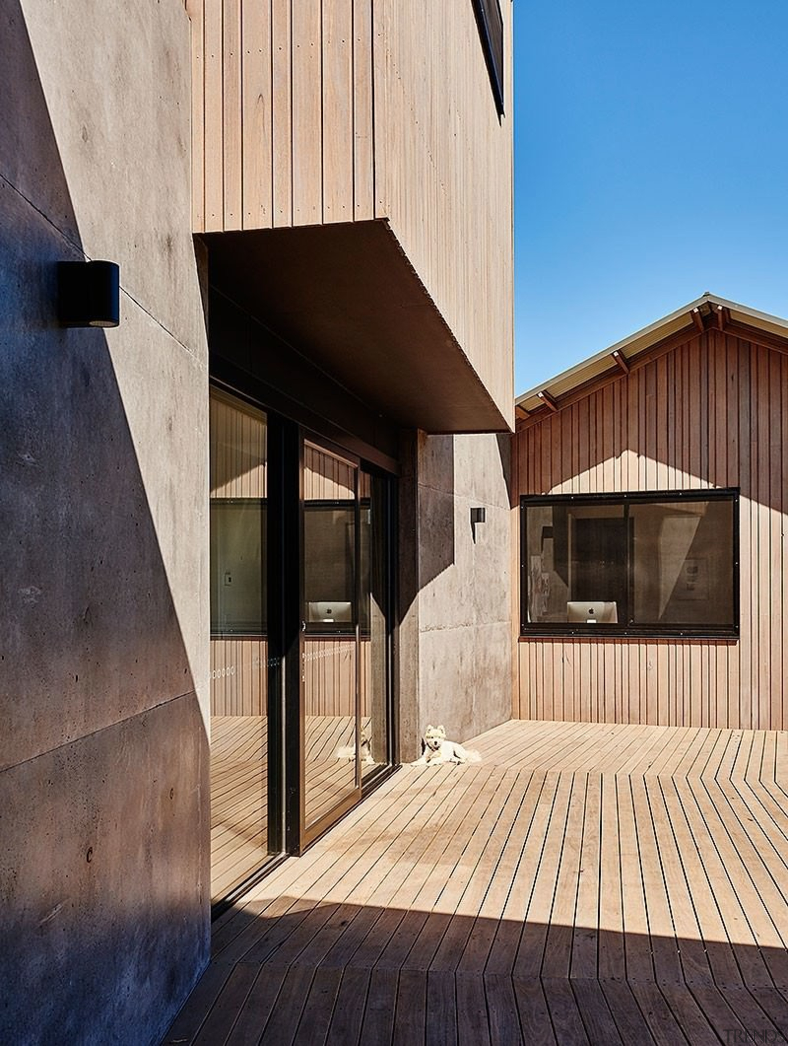 Timber helps the home to blend in with architecture, building, daylighting, facade, home, house, real estate, siding, window, wood, orange, black