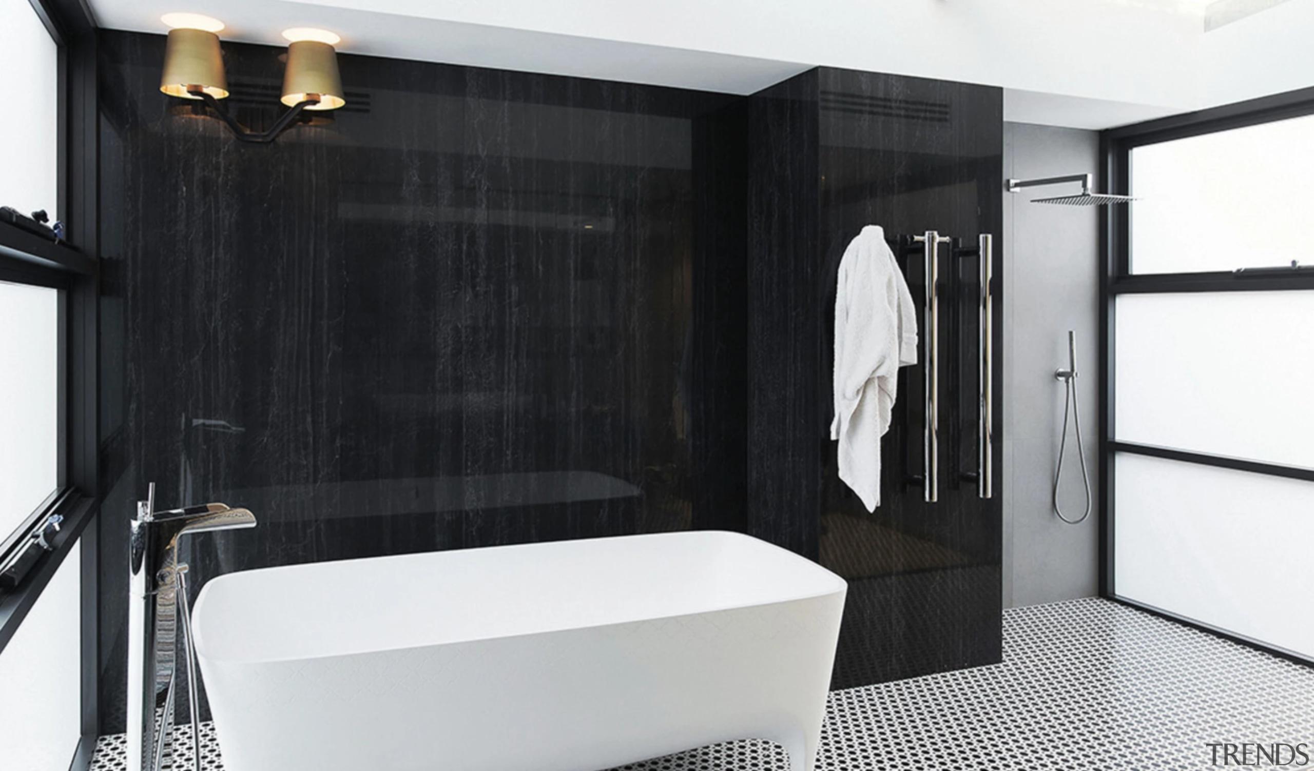 Ceramic, marble and stone tiles are stylish floor bathroom, bathroom cabinet, bathtub, black-and-white, building, door, floor, furniture, interior design, plumbing fixture, property, room, suite, tap, tile, black, white