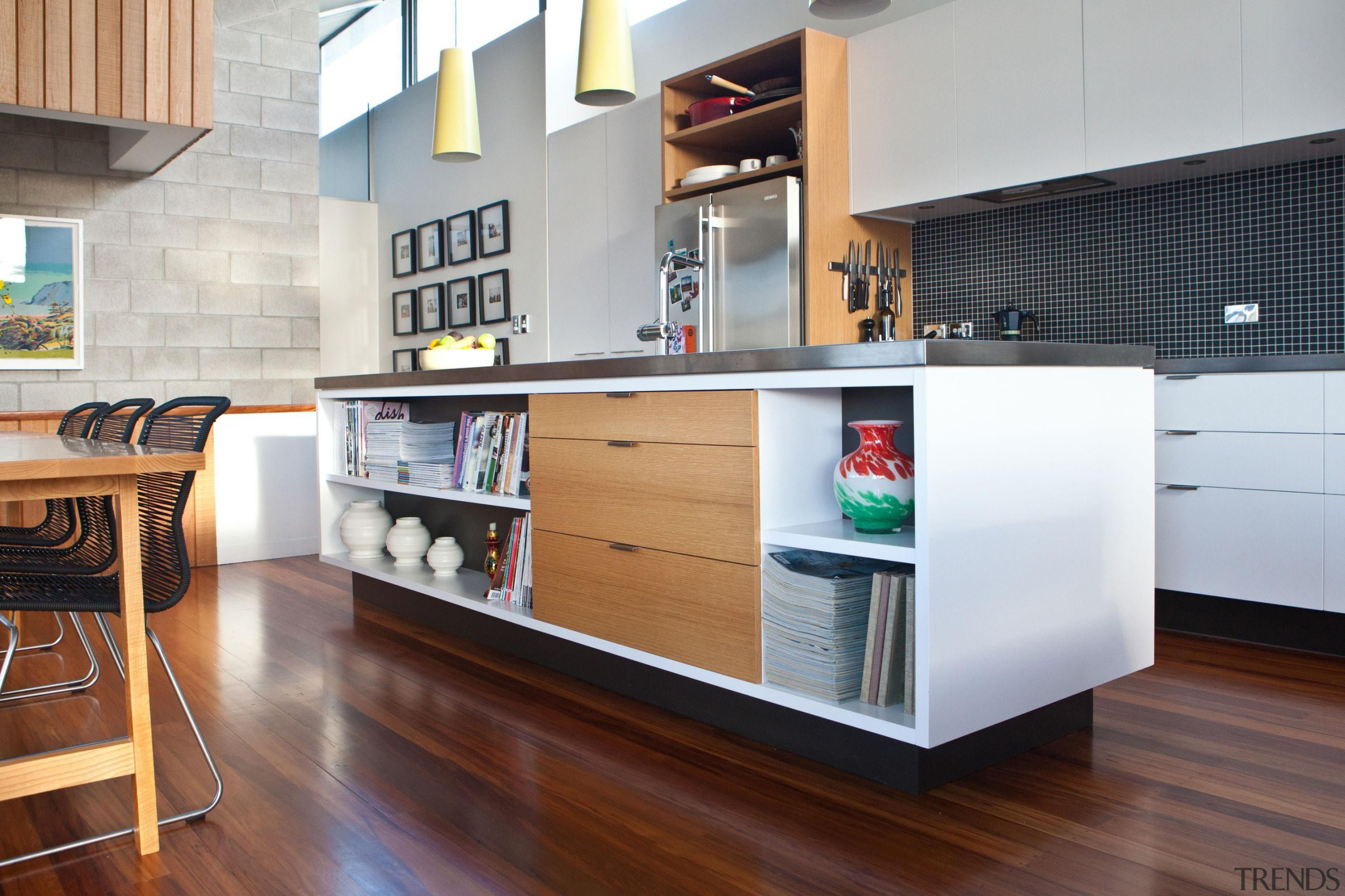 The kitchen island bench provides storage for both cabinetry, countertop, furniture, interior design, kitchen, white