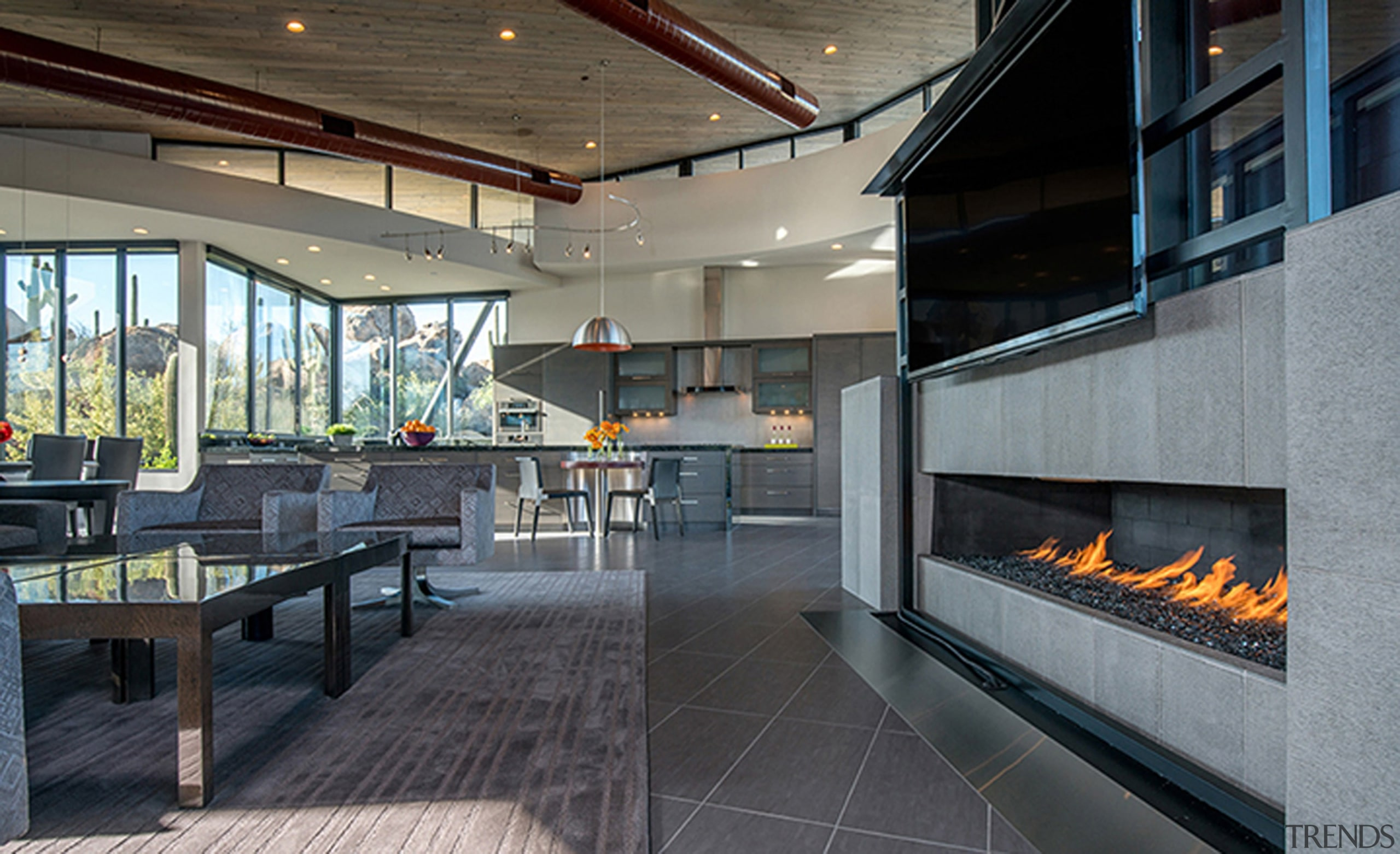 This expansive fireplace is useful at night, given architecture, house, interior design, living room, real estate, gray, black