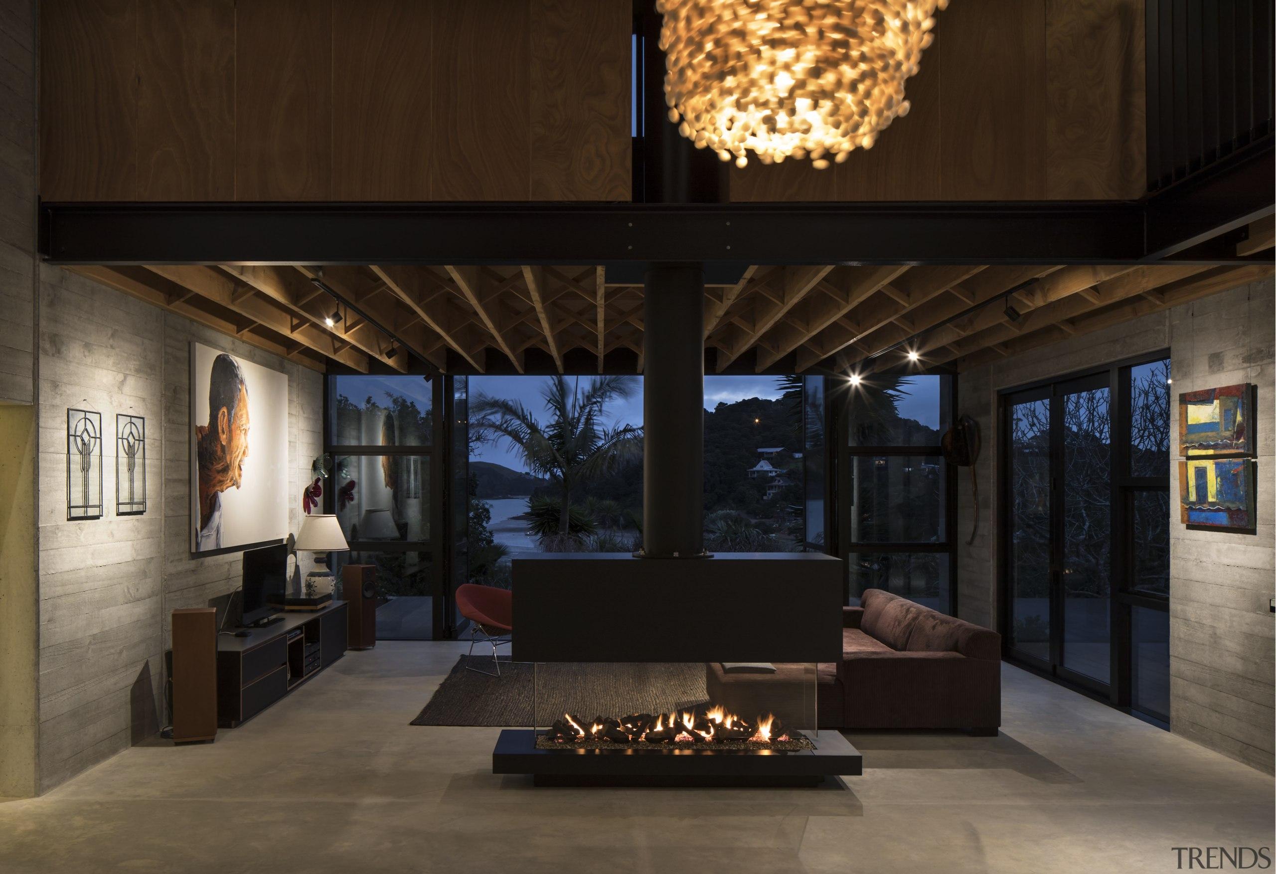 A poured concrete floor and the precast concrete interior design, living room, black, tiles, Vaughn McQuarrie Architects