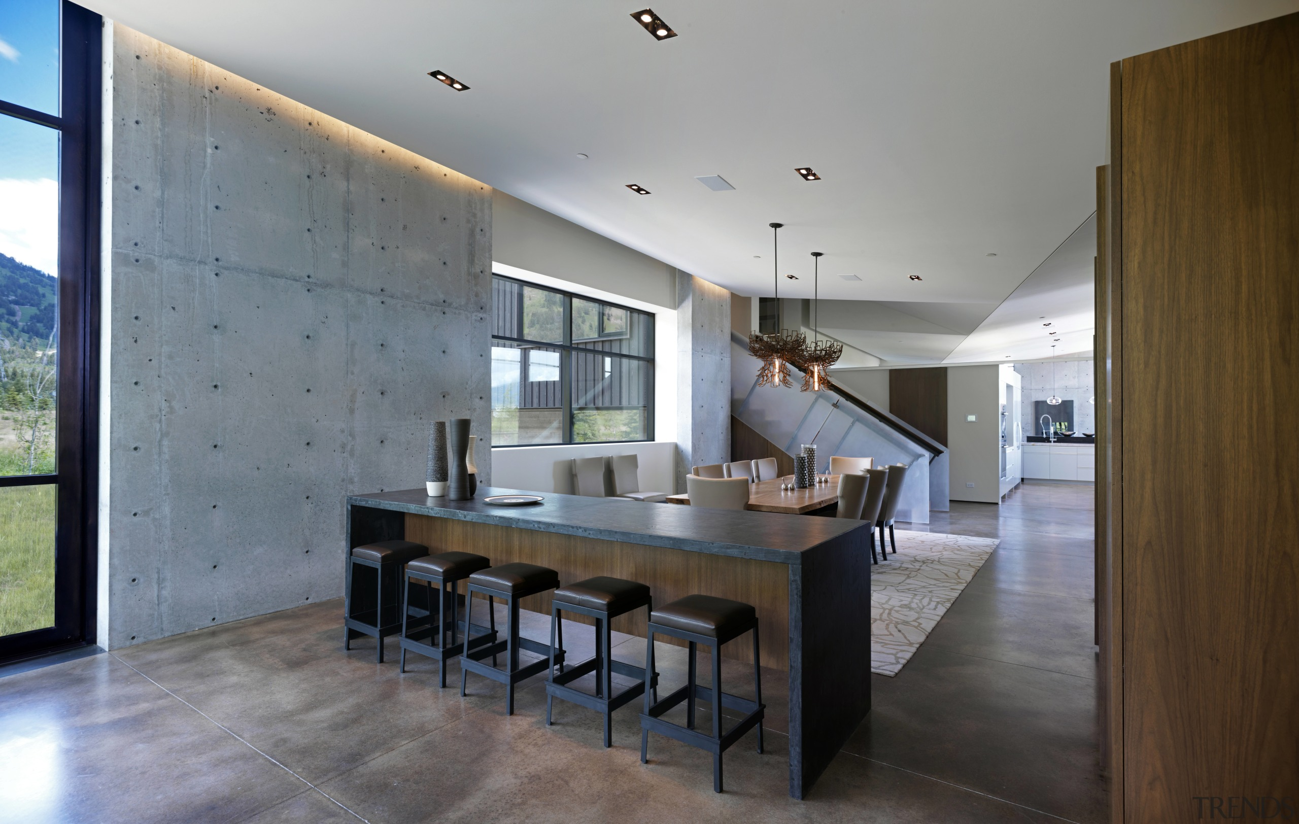 The interior of this mountain home designed by architecture, ceiling, countertop, dining room, estate, floor, flooring, house, interior design, kitchen, real estate, room, table, gray