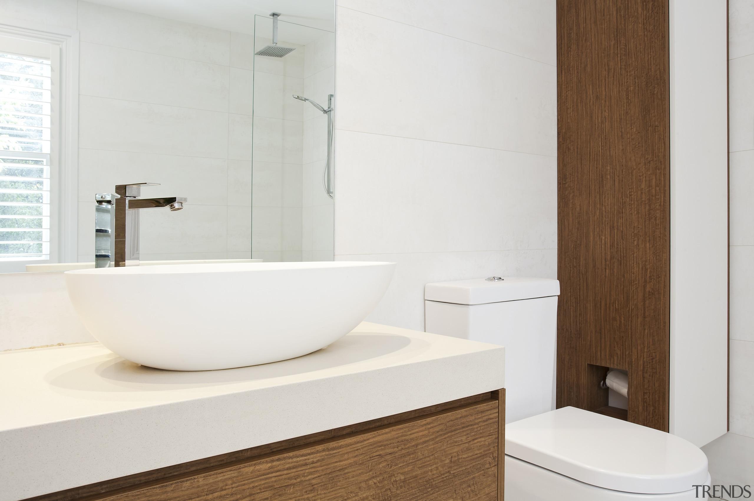 In this bathroom by designer Anna Klimova, recessed bathroom, bathroom accessory, bathroom cabinet, bathroom sink, bidet, ceramic, floor, interior design, plumbing fixture, product design, room, sink, tap, toilet seat, white
