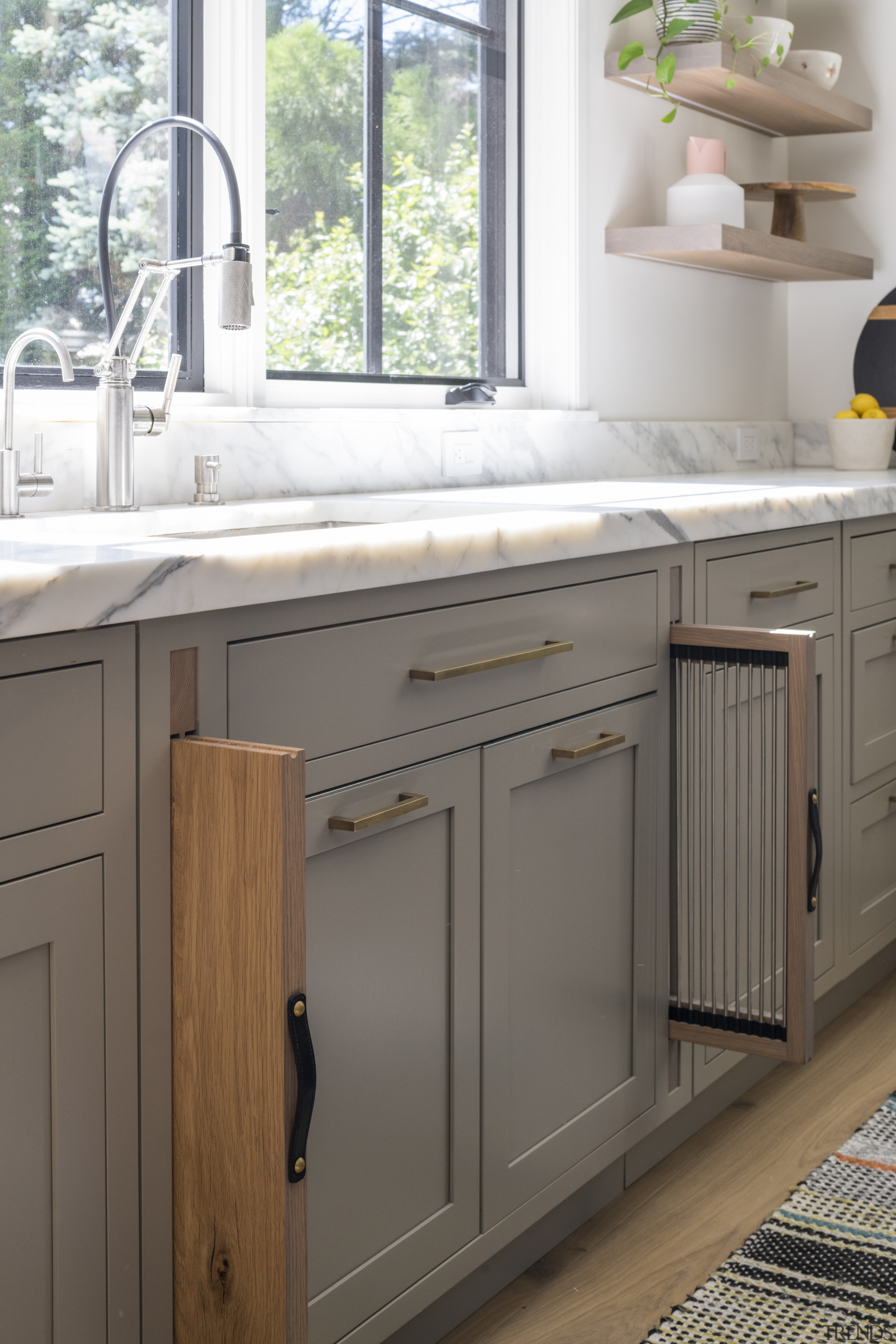 A dish drying rack and chopping board storage