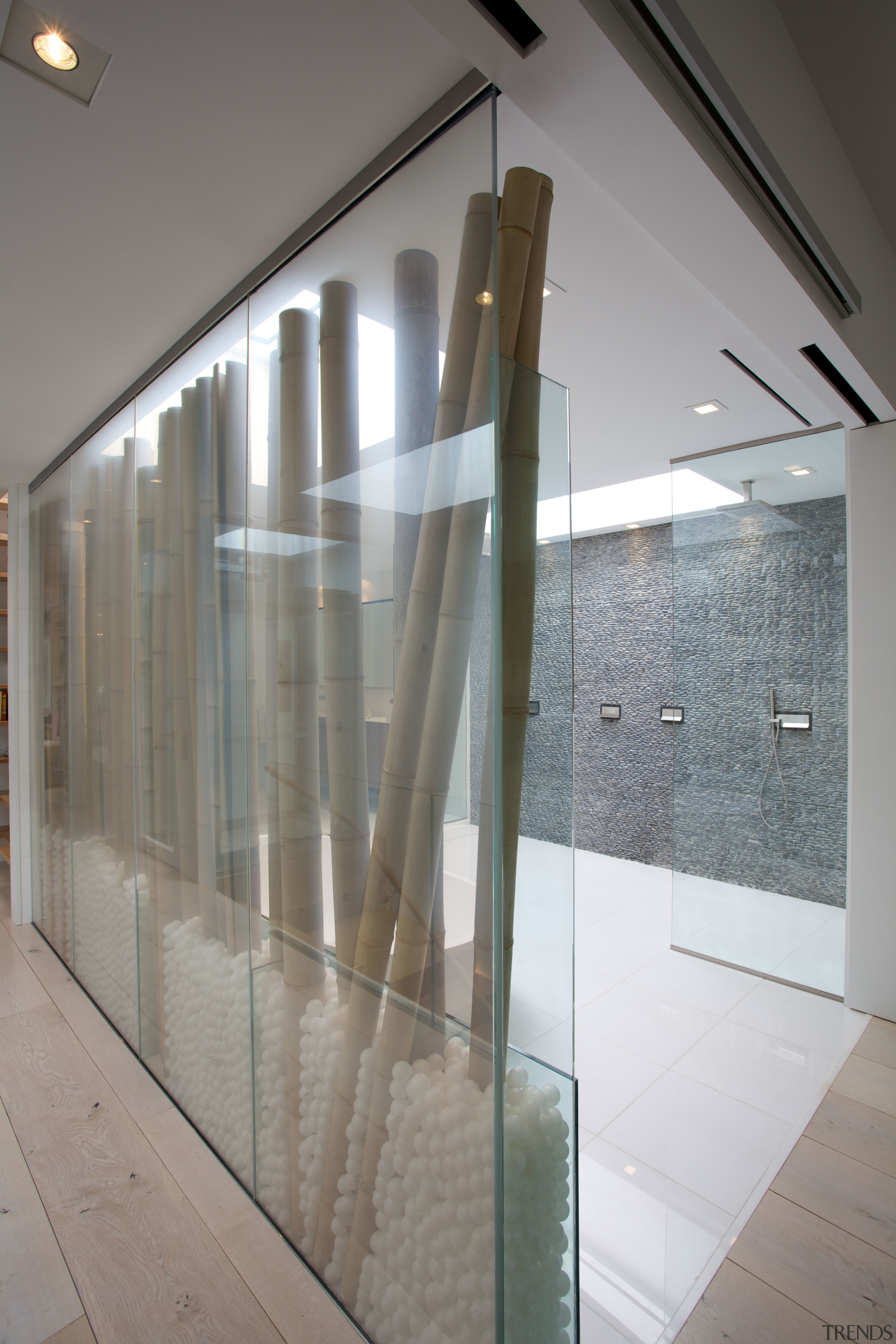 This electric glass screen can turn opaque at architecture, daylighting, floor, glass, handrail, interior design, lobby, gray
