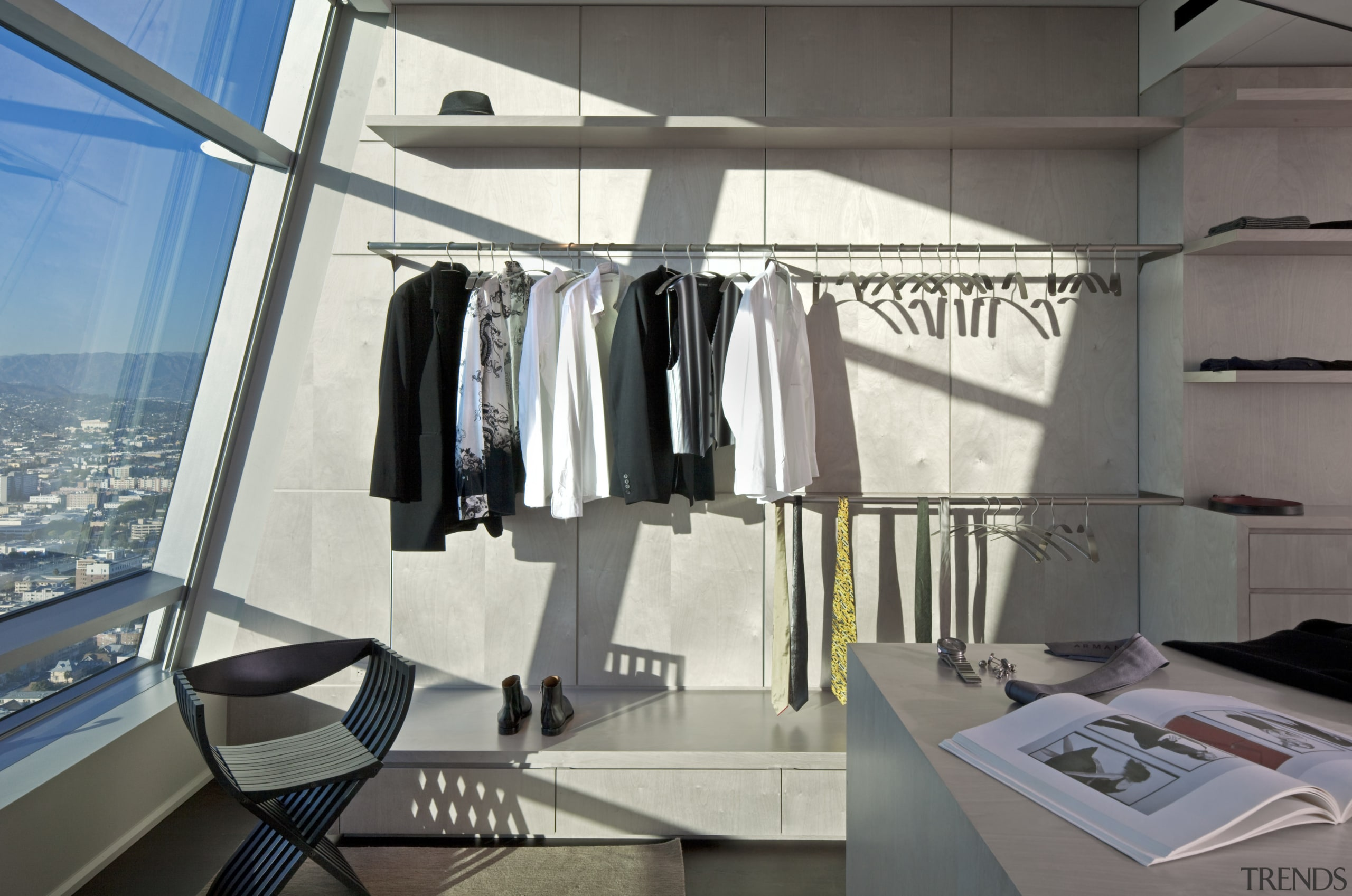 The dressing room in the master suite resembles product design, gray, white