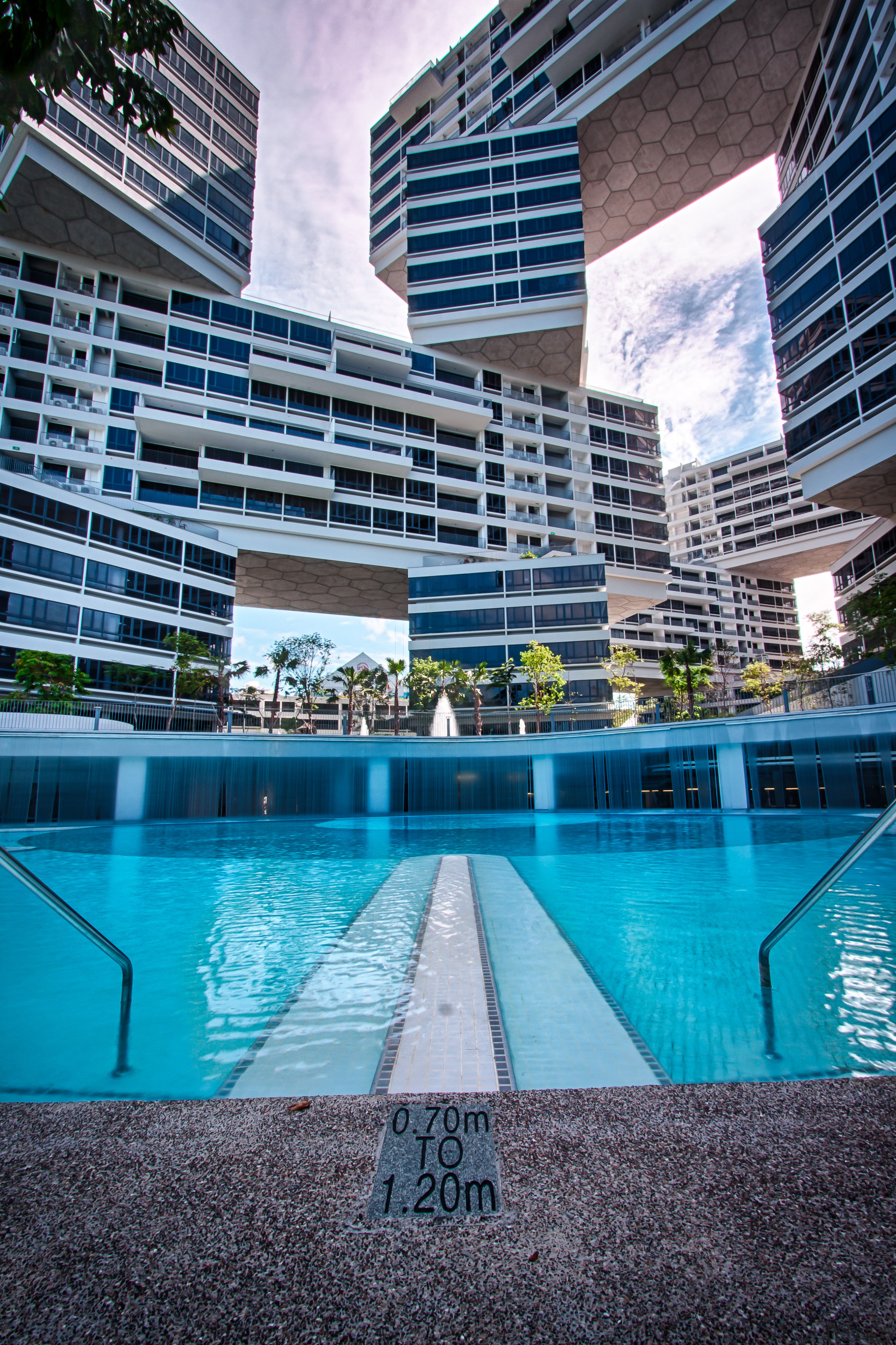 Swimming pool at The Interlace apartment, Singapore architecture, building, condominium, corporate headquarters, daytime, hotel, leisure, leisure centre, metropolitan area, mixed use, property, real estate, reflection, resort, swimming pool, vacation, water, teal