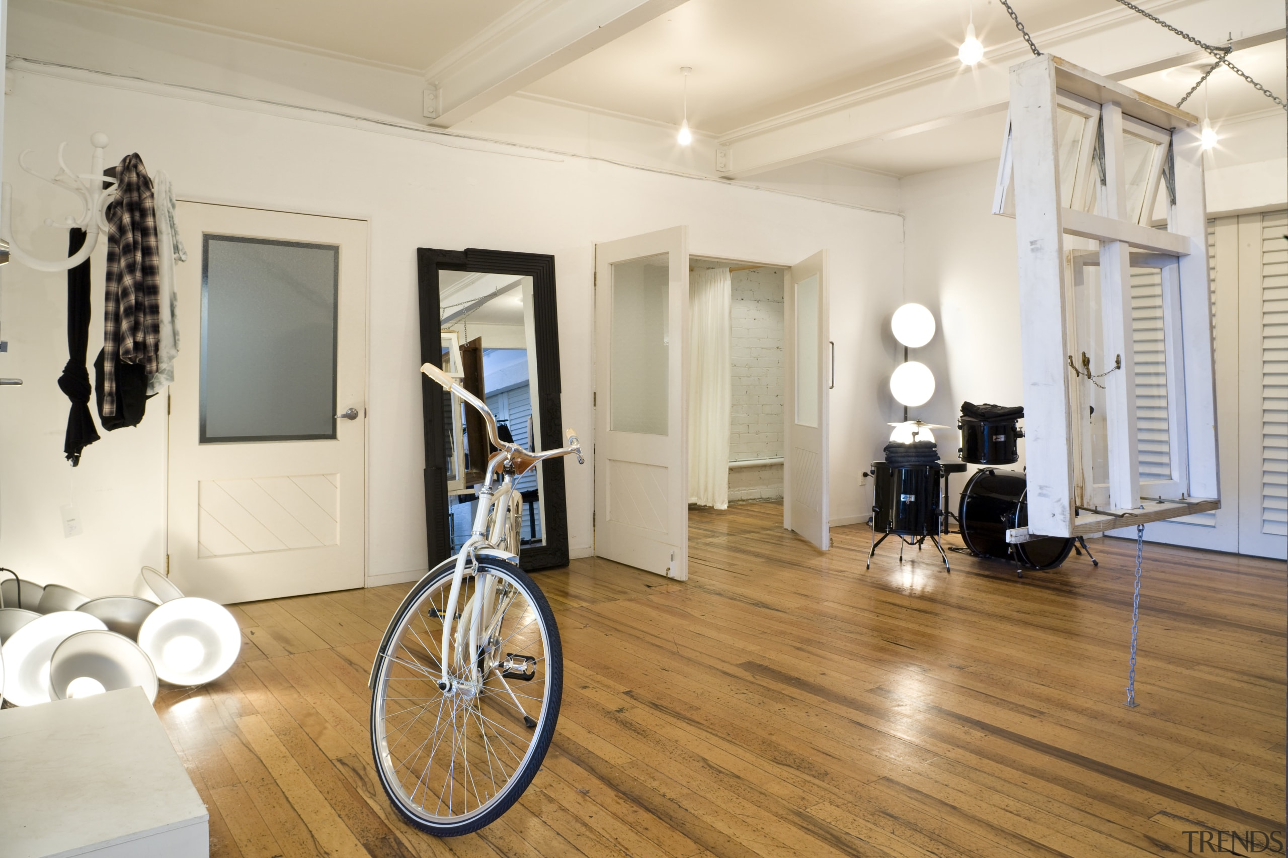 Interior view of the clothing displays at the floor, flooring, hardwood, home, interior design, laminate flooring, room, wood, wood flooring, white