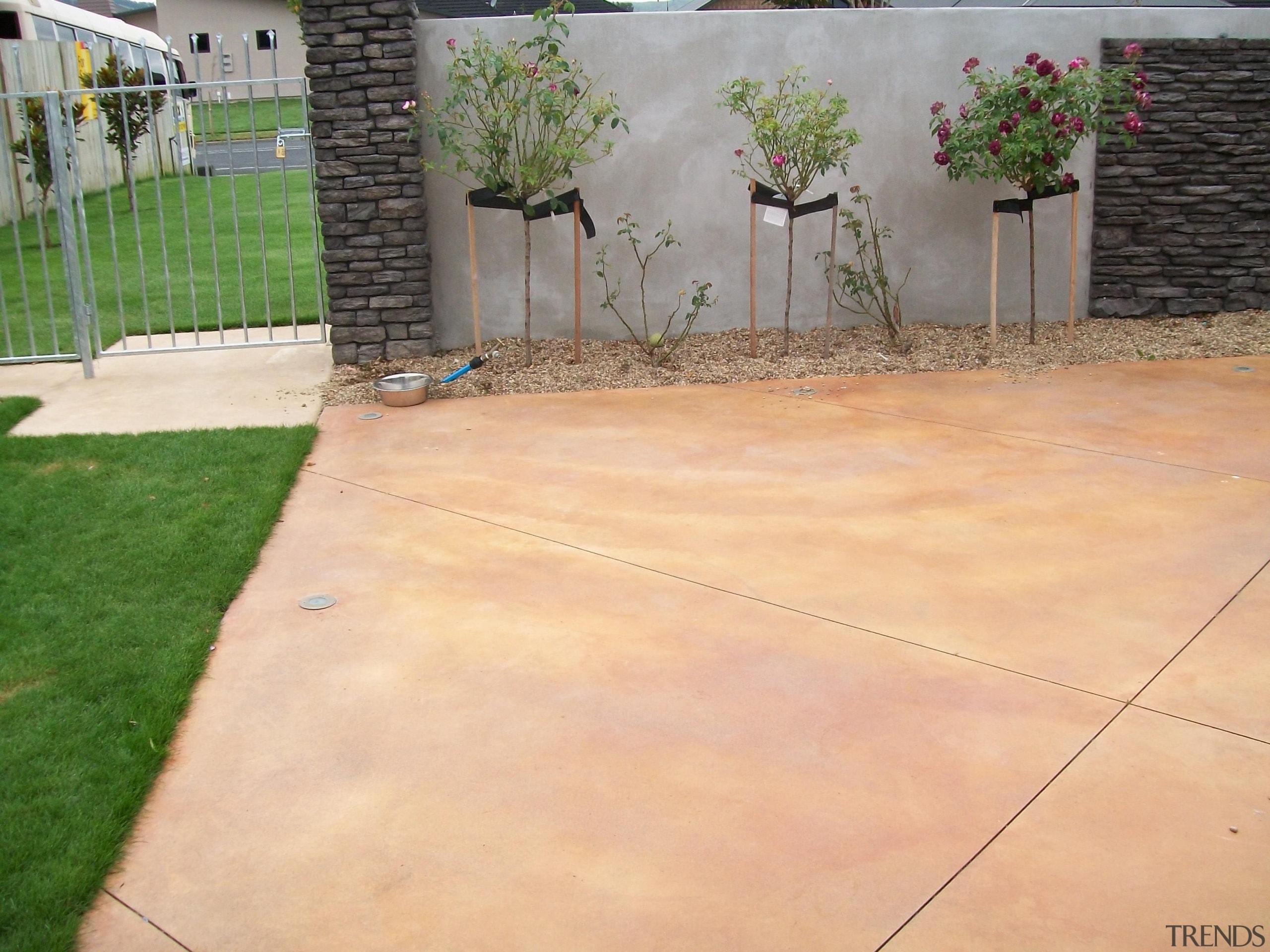 Colourmix 25 - Colourmix_25 - backyard   concrete backyard, concrete, driveway, floor, grass, outdoor structure, property, road surface, walkway, yard, orange