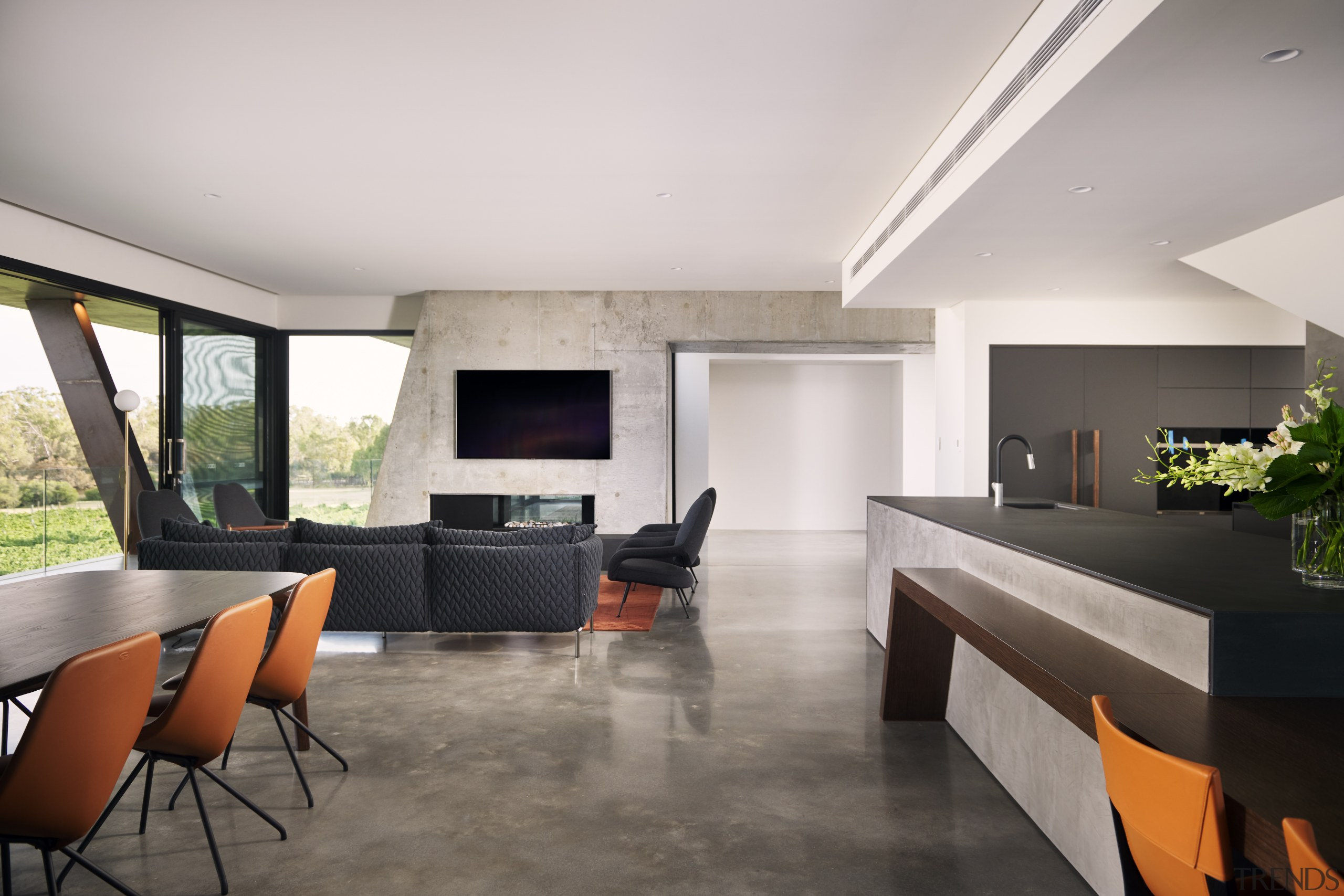 Contrasting the kitchen and interior's block-like forms, the