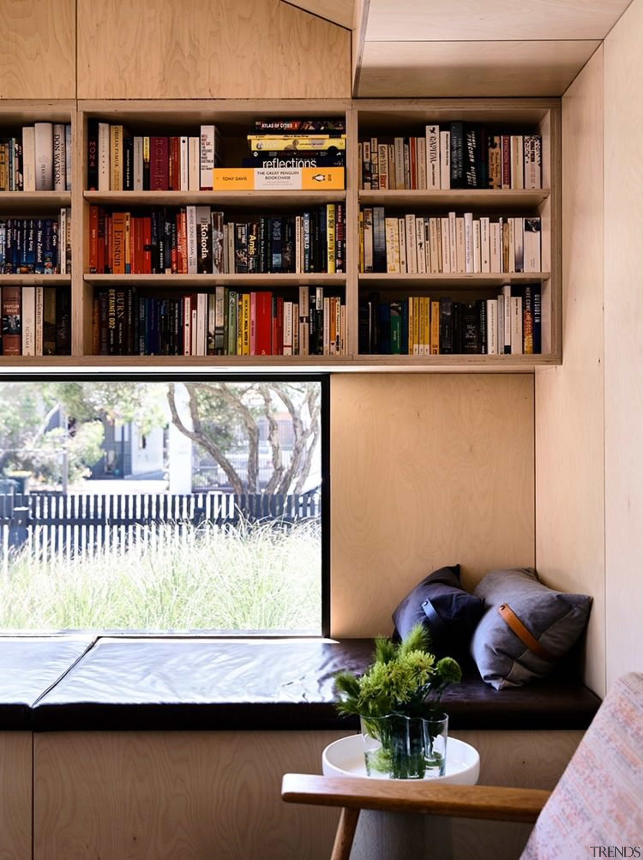This bookshelf is compact and packed in above bookcase, furniture, home, interior design, living room, shelf, shelving