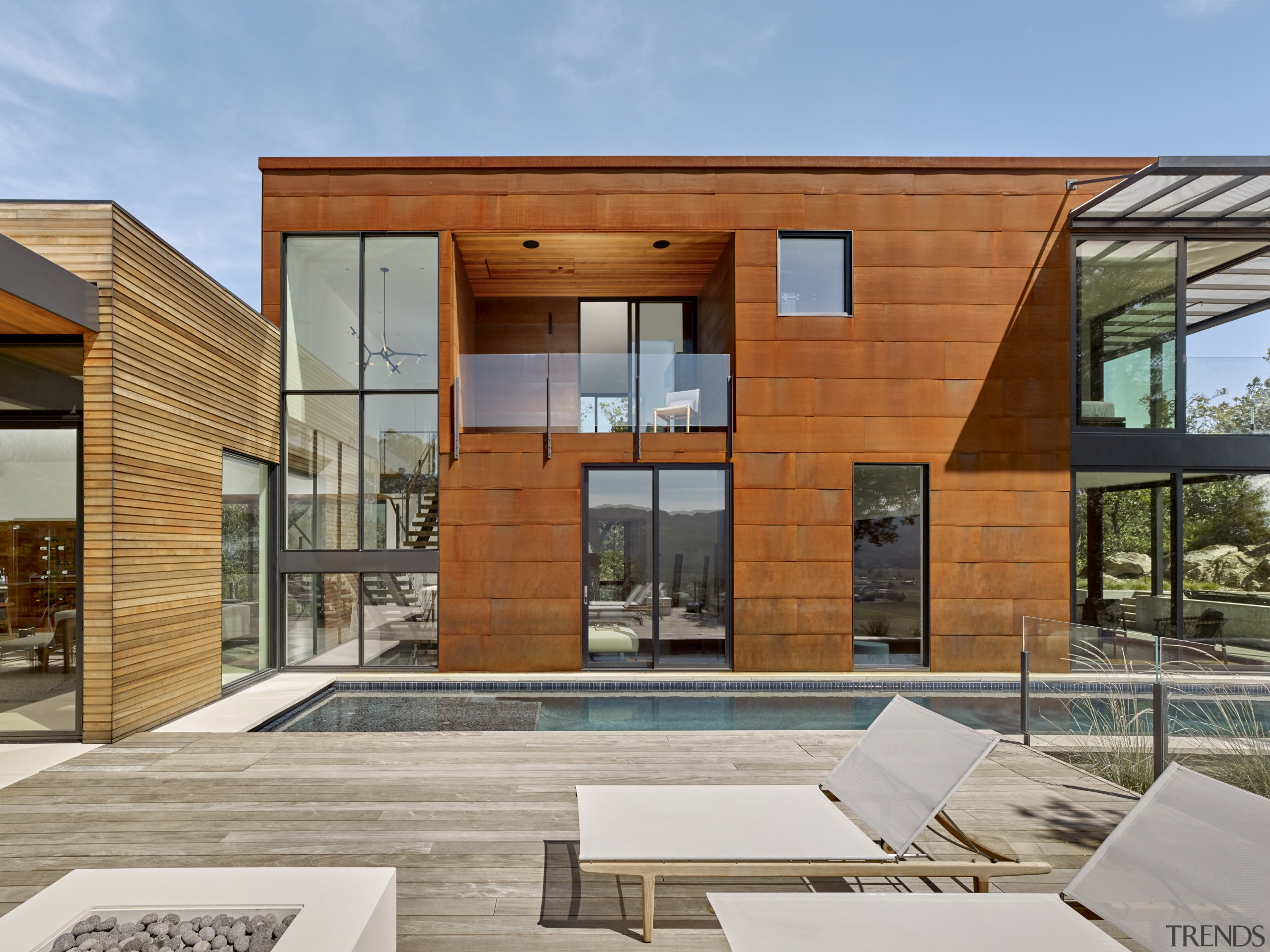 In contrast to the wood box that contains architecture, design, facade, home, house, timber cladding, pool, de Vito Architecture + Construction
