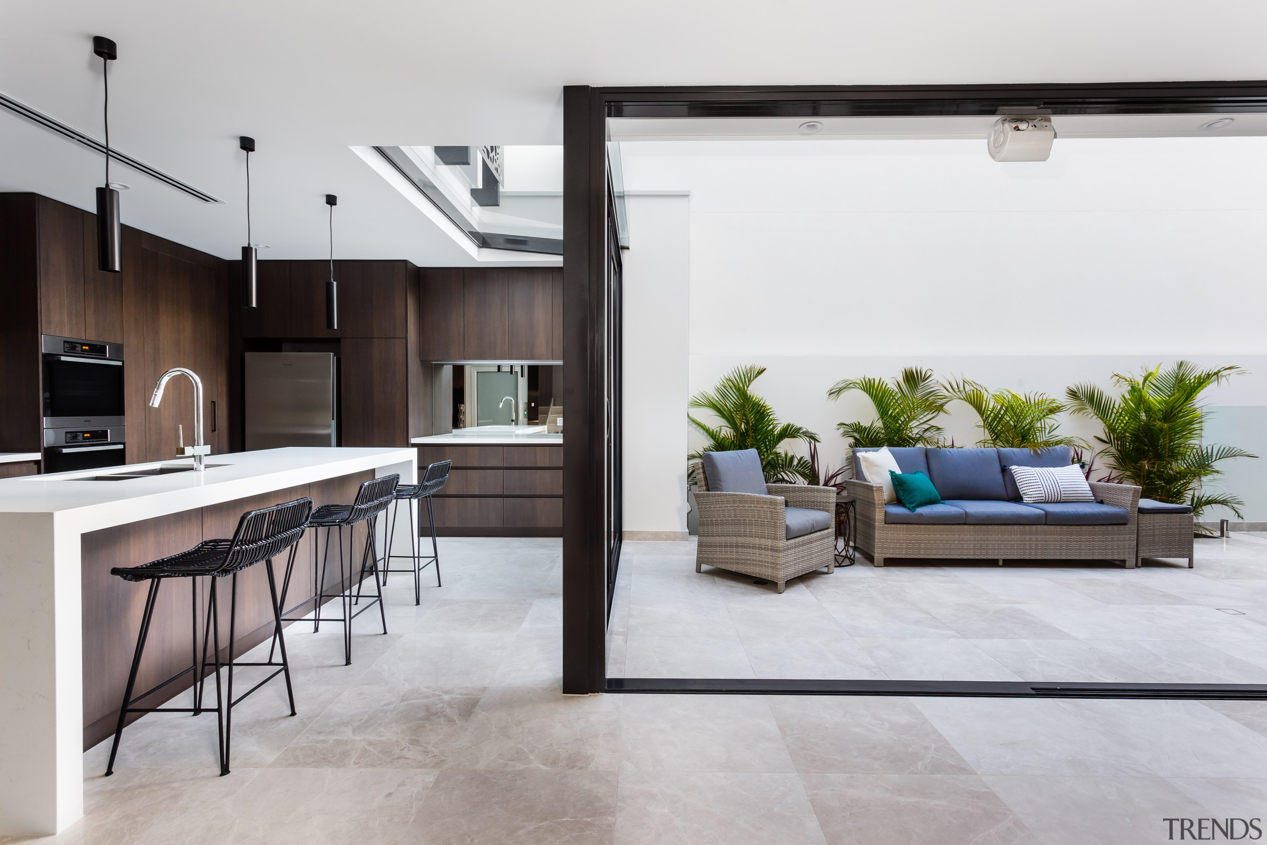 This clean-lined kitchen forms part of a whole-house floor, interior design, living room, white, gray