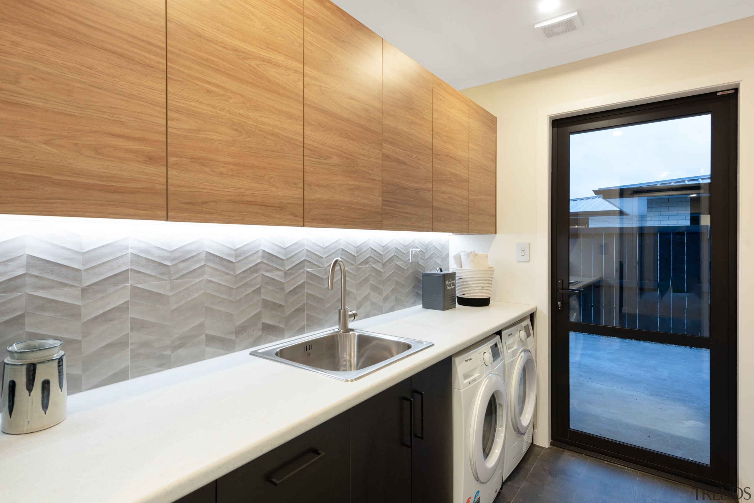 Underlit wood cabinetry also shows off the textural