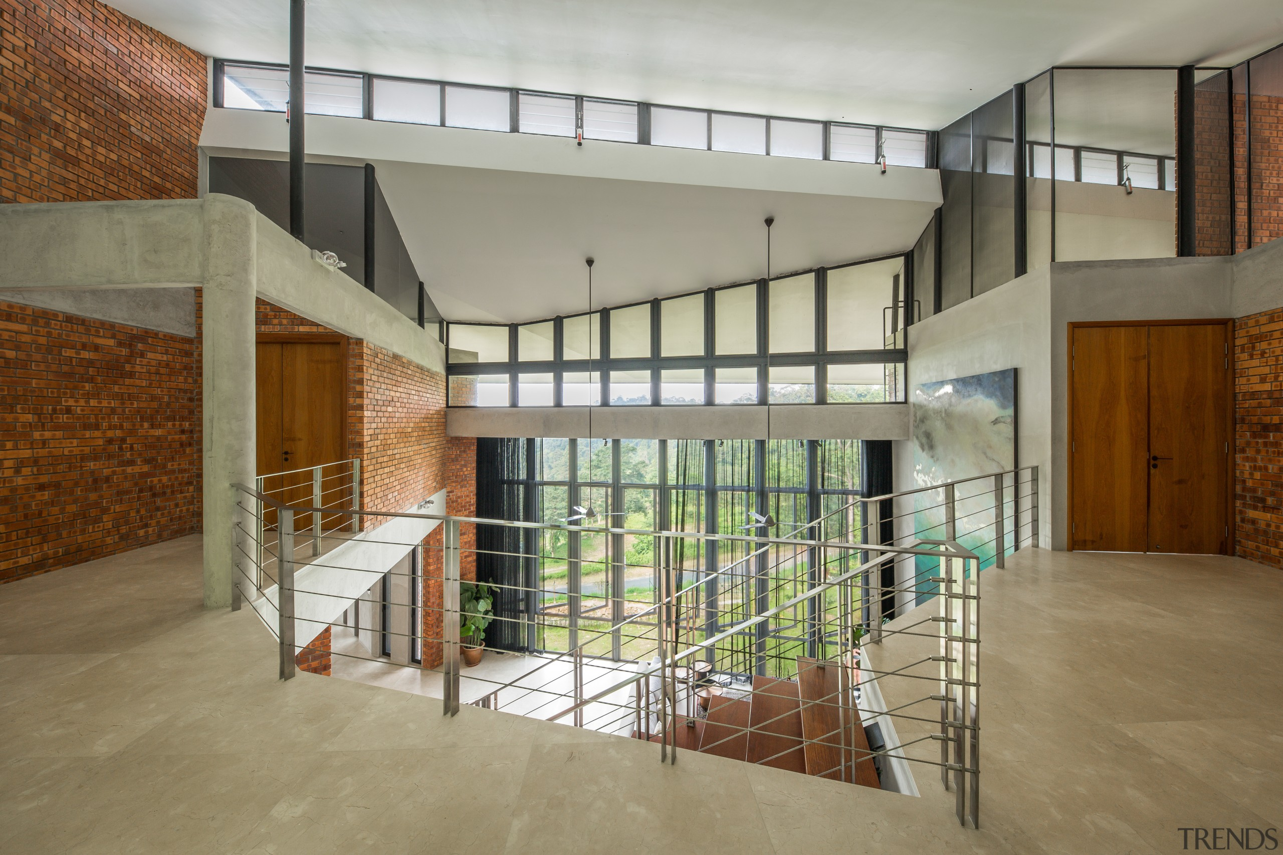 The dramatic entrance to the 5-bedroom home. Light apartment, architecture, building, ceiling, daylighting, design, estate, floor, flooring, hall, handrail, home, house, interior design, loft, property, real estate, residential area, room, stairs, window, gray, brown