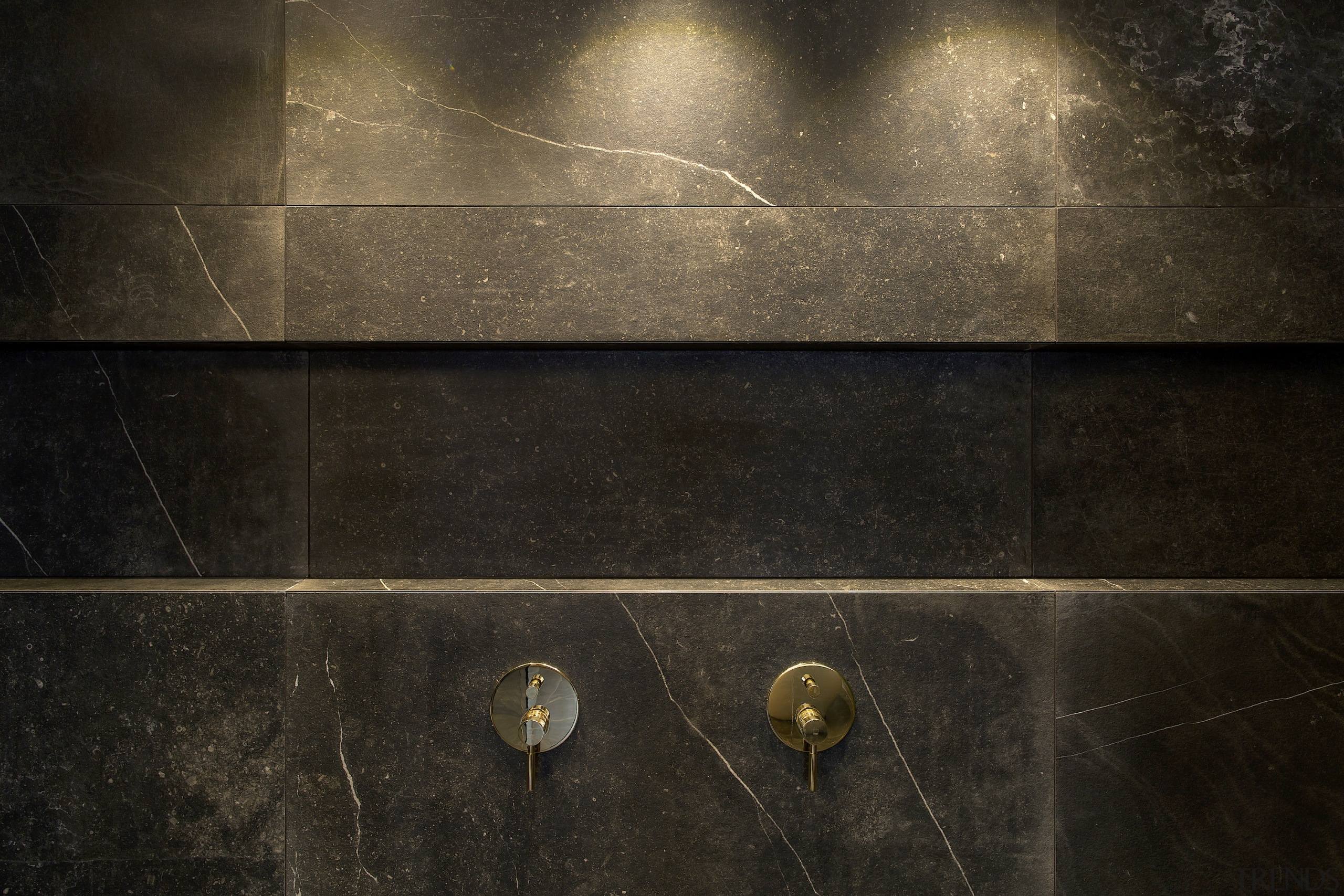 A long recessed shower niche is both handy