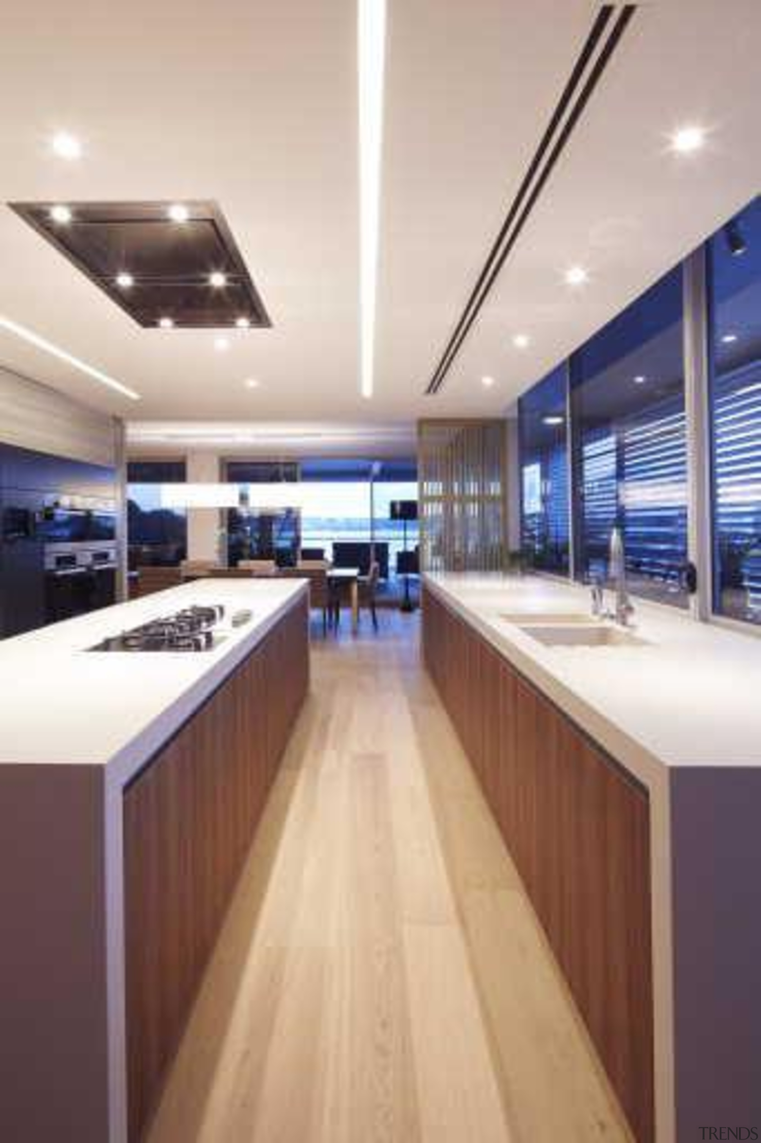 In this contemporary apartment renovation, woodgrain surfaces from ceiling, countertop, floor, interior design, kitchen, yacht, gray