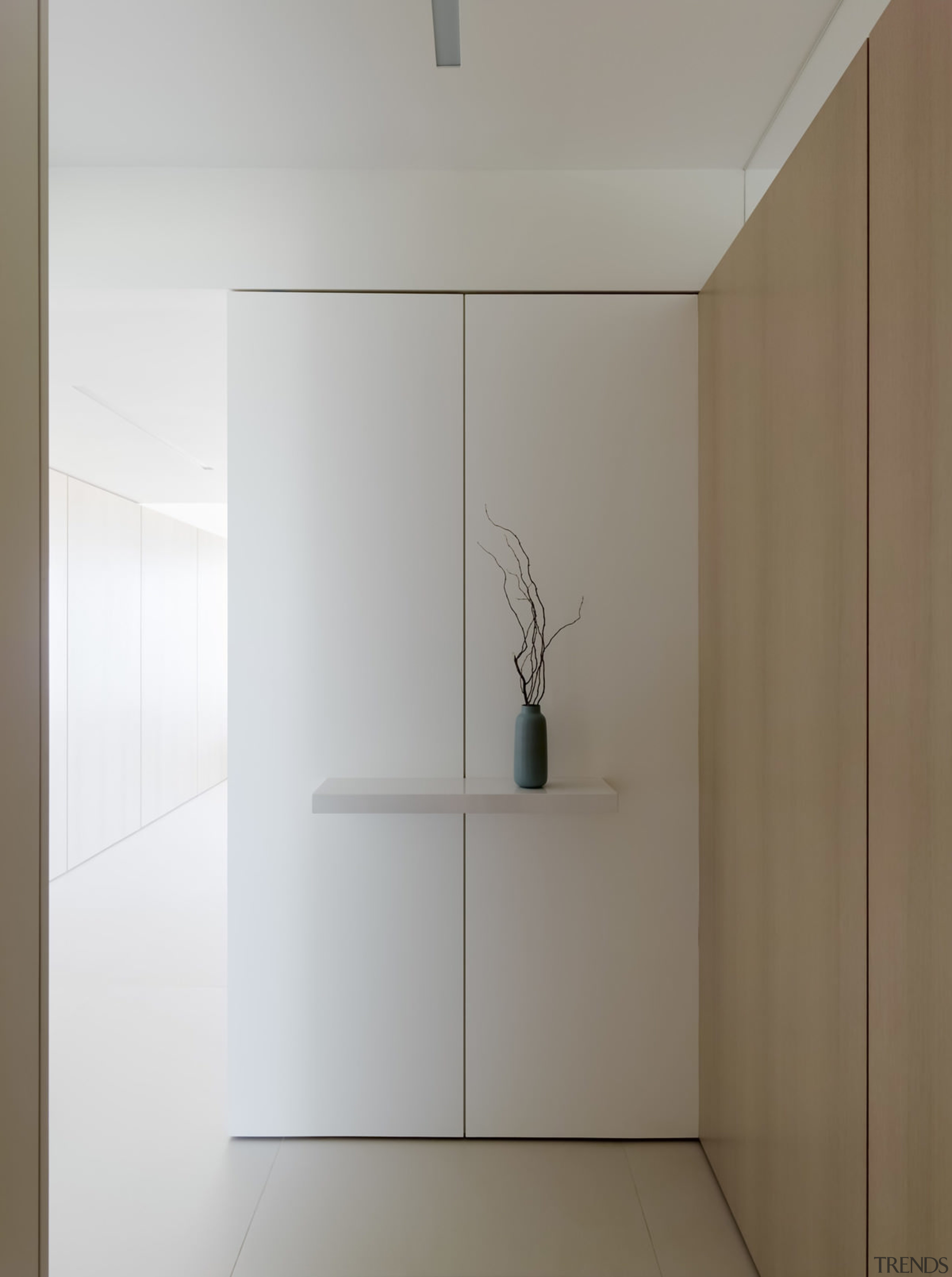 With white walls and simple wood panels, the architecture, interior design, product design, gray, white, brown