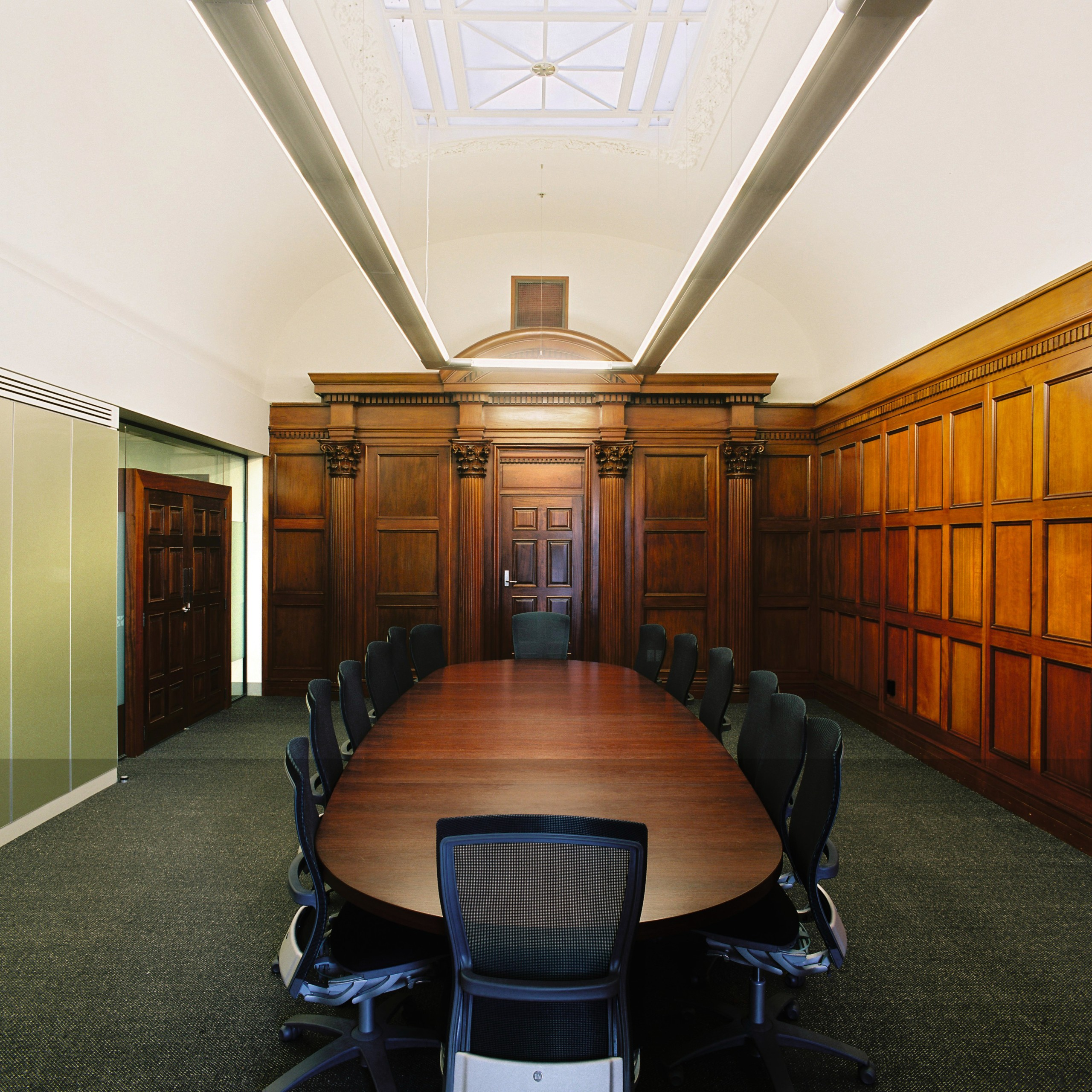 A view of the formal boardroom featuring wood ceiling, conference hall, furniture, interior design, brown, white