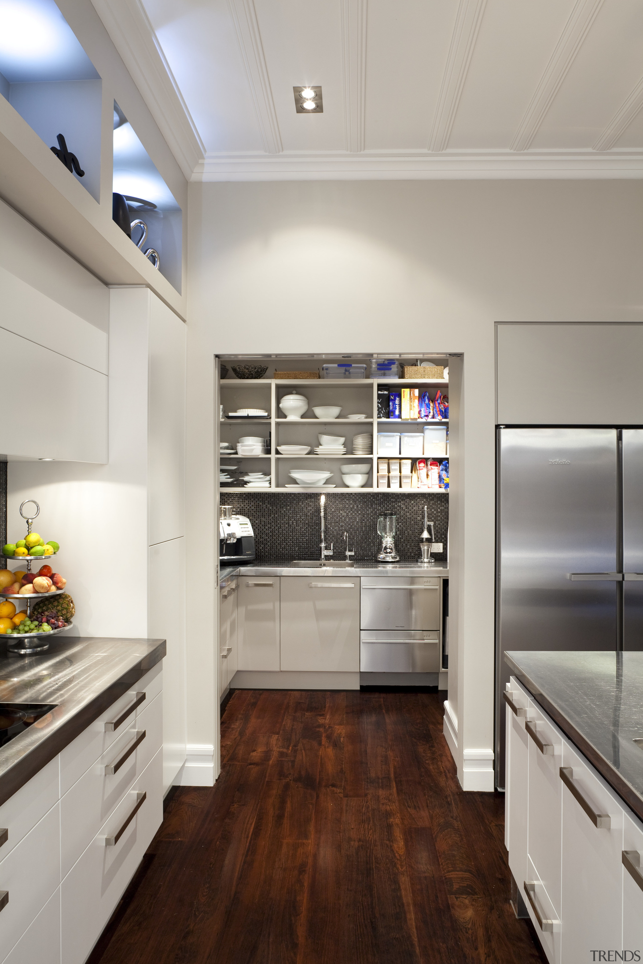 scullery through open archway at rear of kitchen cabinetry, countertop, cuisine classique, floor, flooring, hardwood, home appliance, interior design, kitchen, room, wood flooring, gray