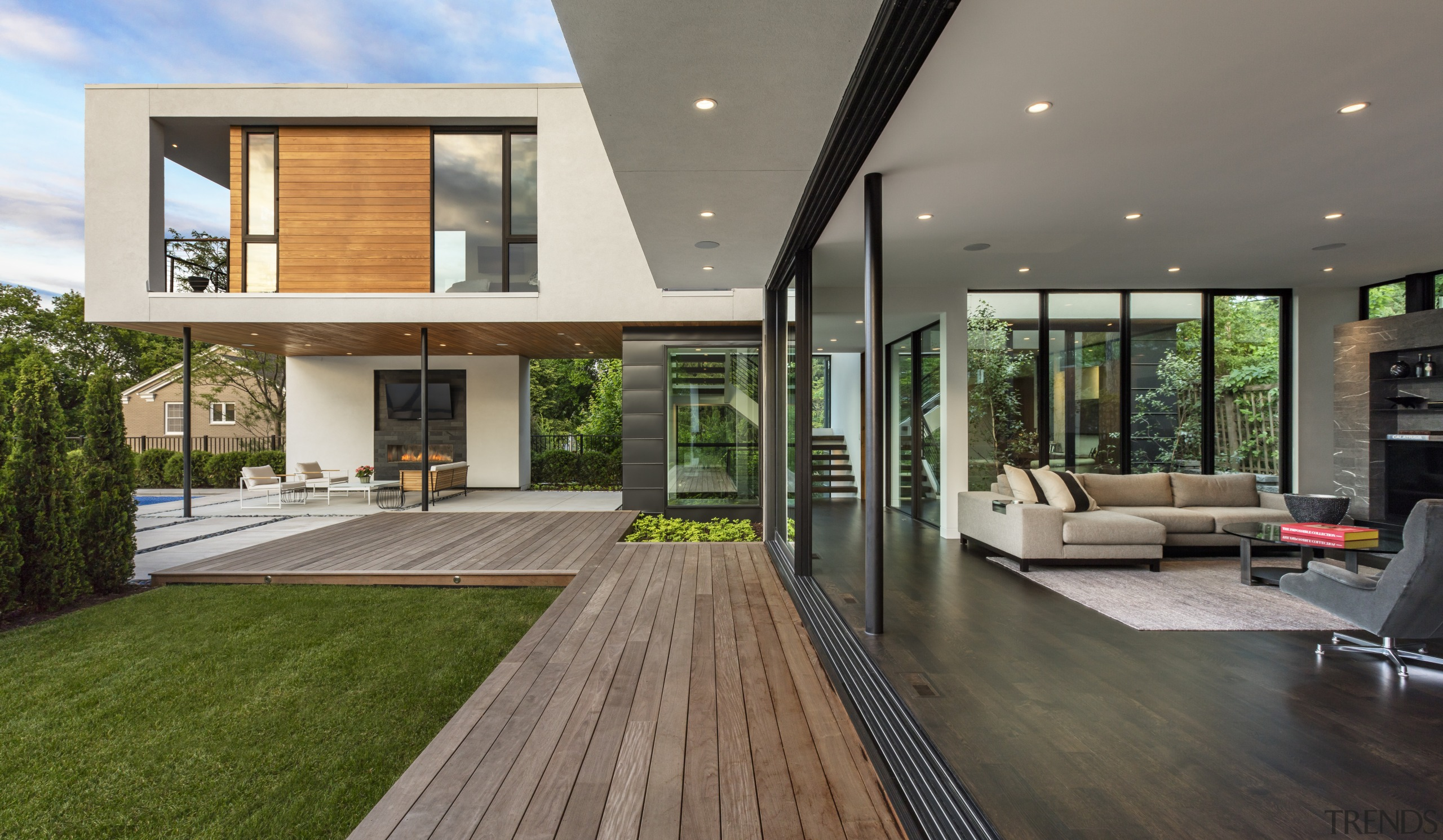 ​​​​​​​A series of glass sliding panels allows the architecture, deck, home, house, interior design, living room, patio, window, sliding windows, Peterssen Keller Architects
