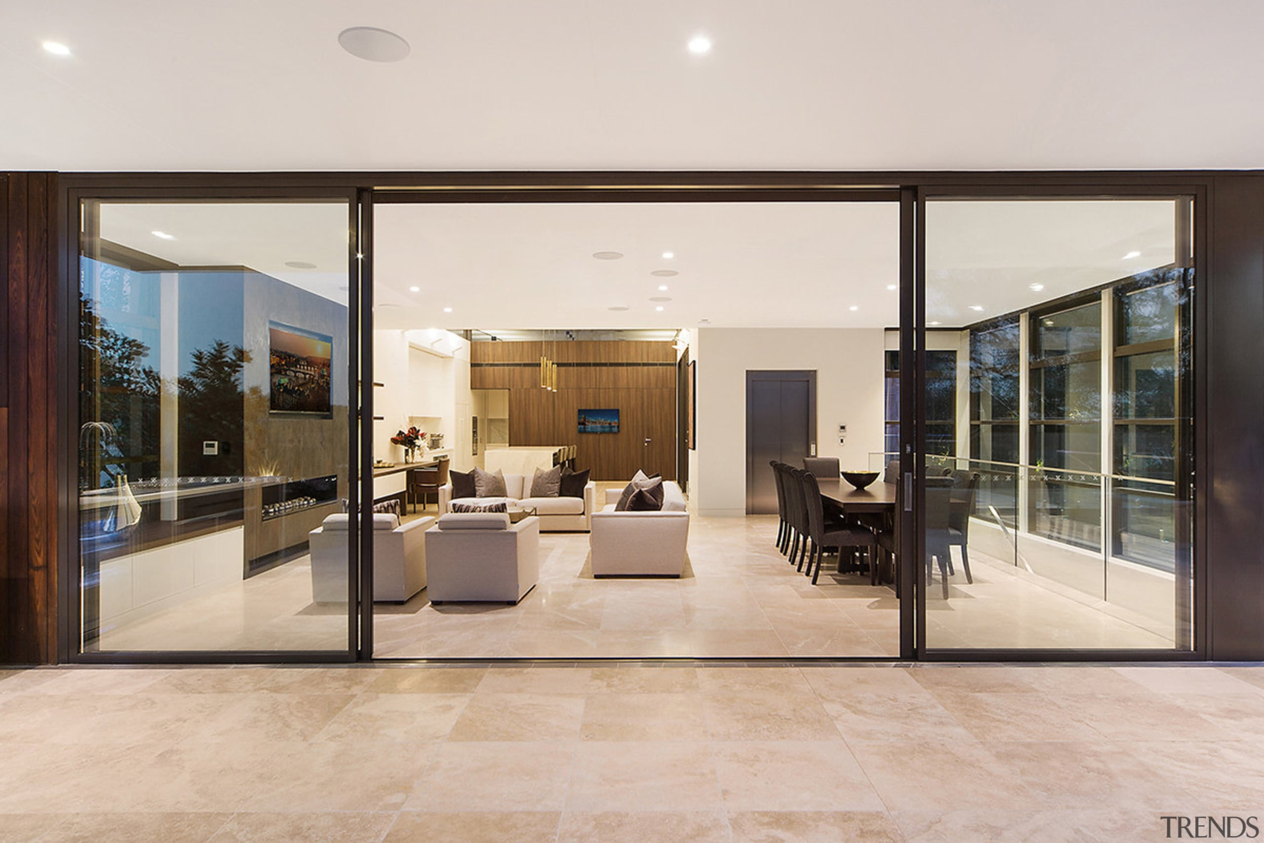 On this top floor of a three-level Sydney door, floor, flooring, house, interior design, lobby, real estate, window, gray