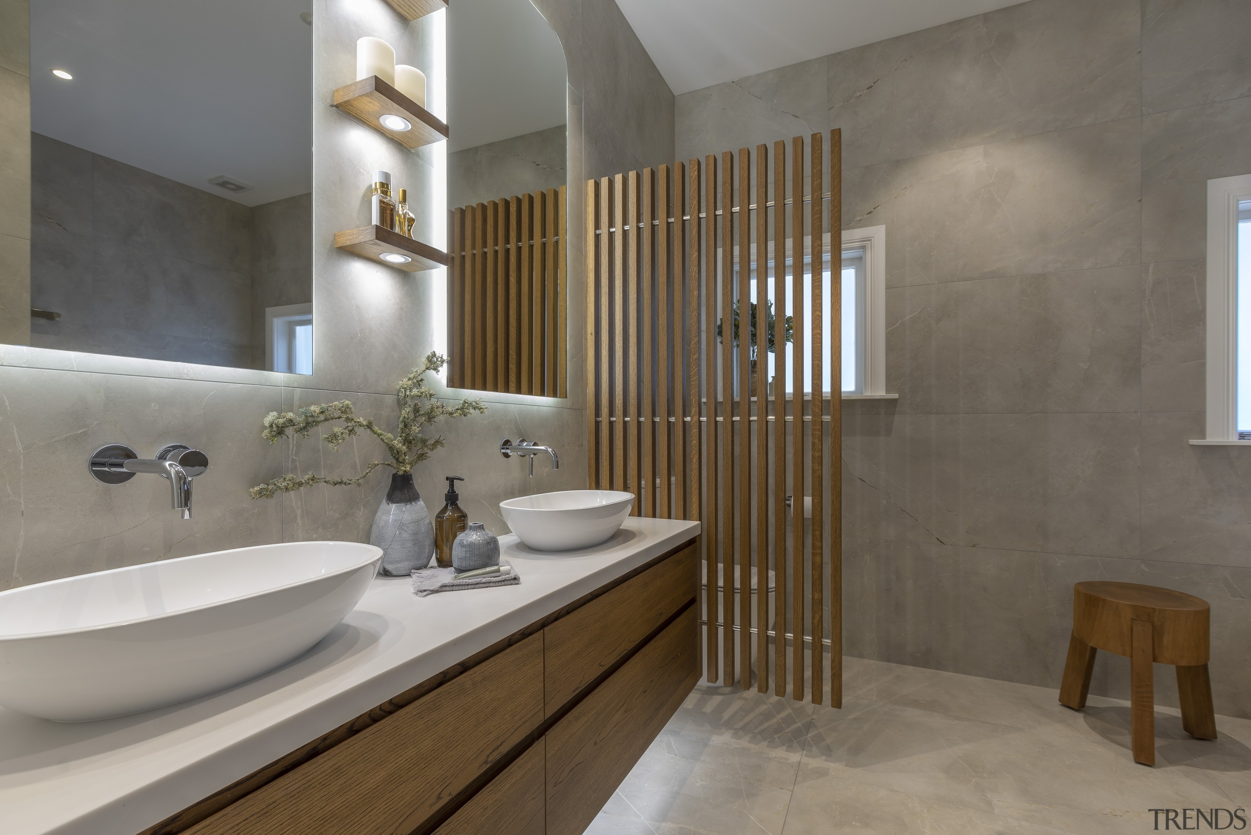Small display shelves are underlit in this bathroom gray