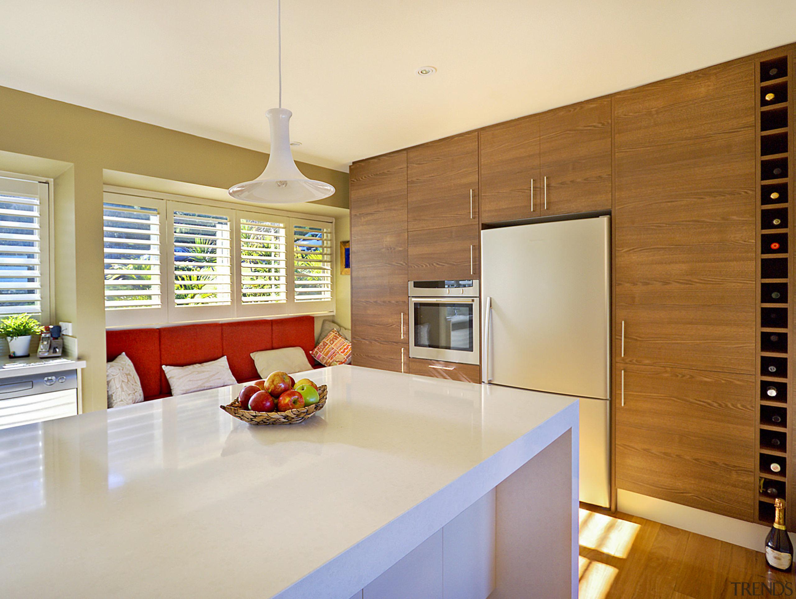 View of kitchen featuring wood floors, white bench countertop, interior design, kitchen, real estate, room, orange, brown