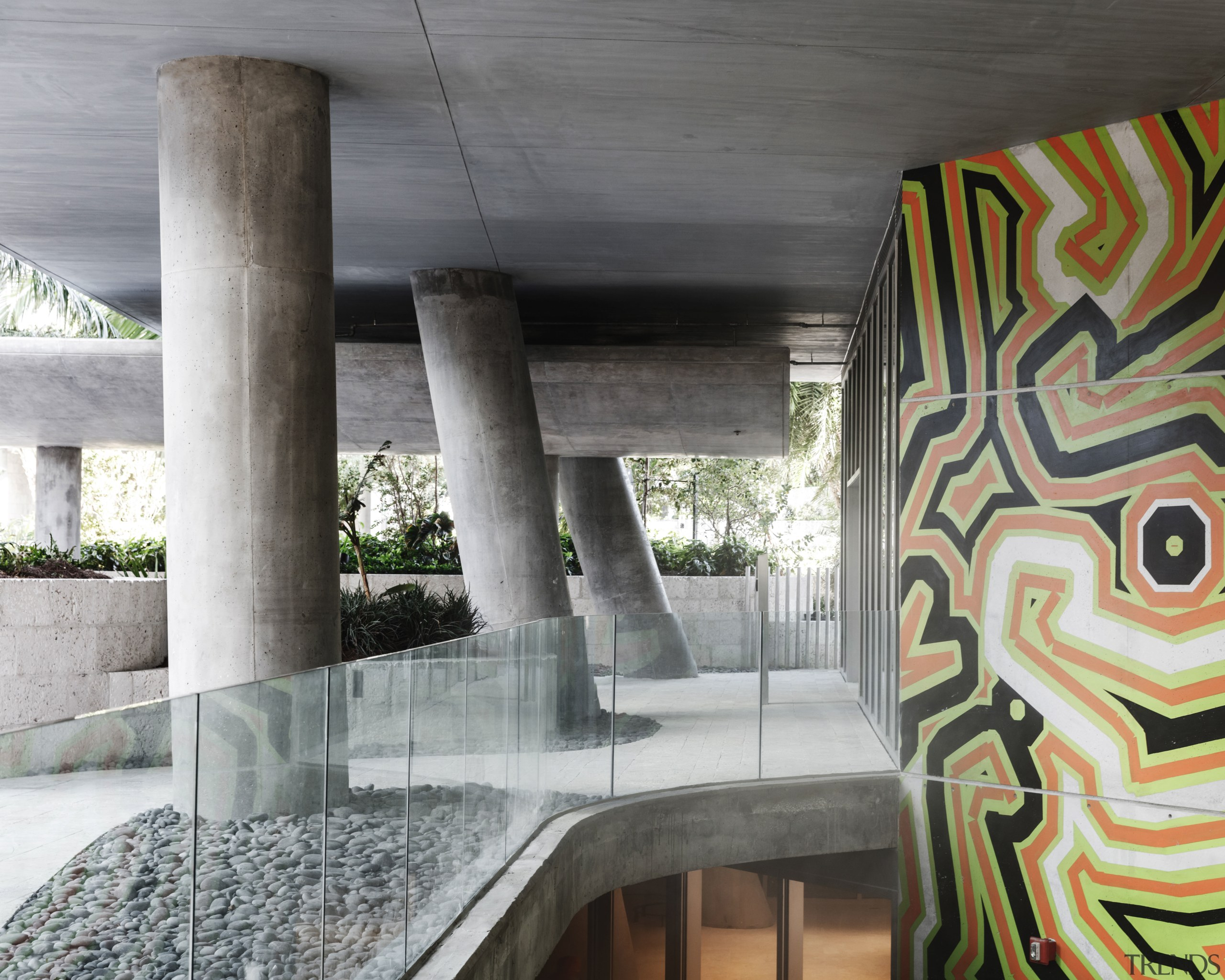Murals add touches of vibrancy to the design architecture, structure, wall, gray