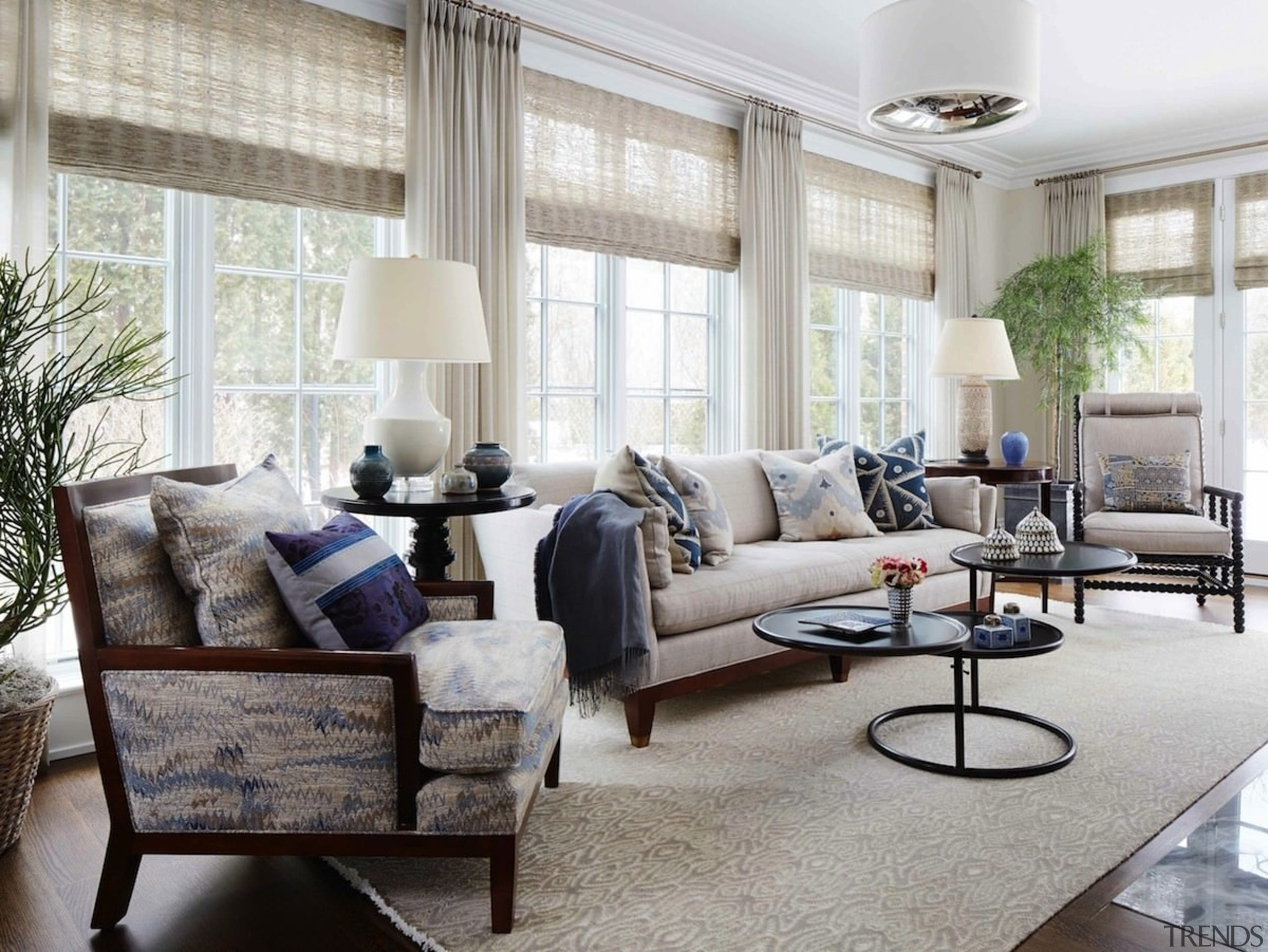 This large sitting room features expansive windows floor, furniture, home, interior design, living room, room, window, window covering, window treatment, gray, white