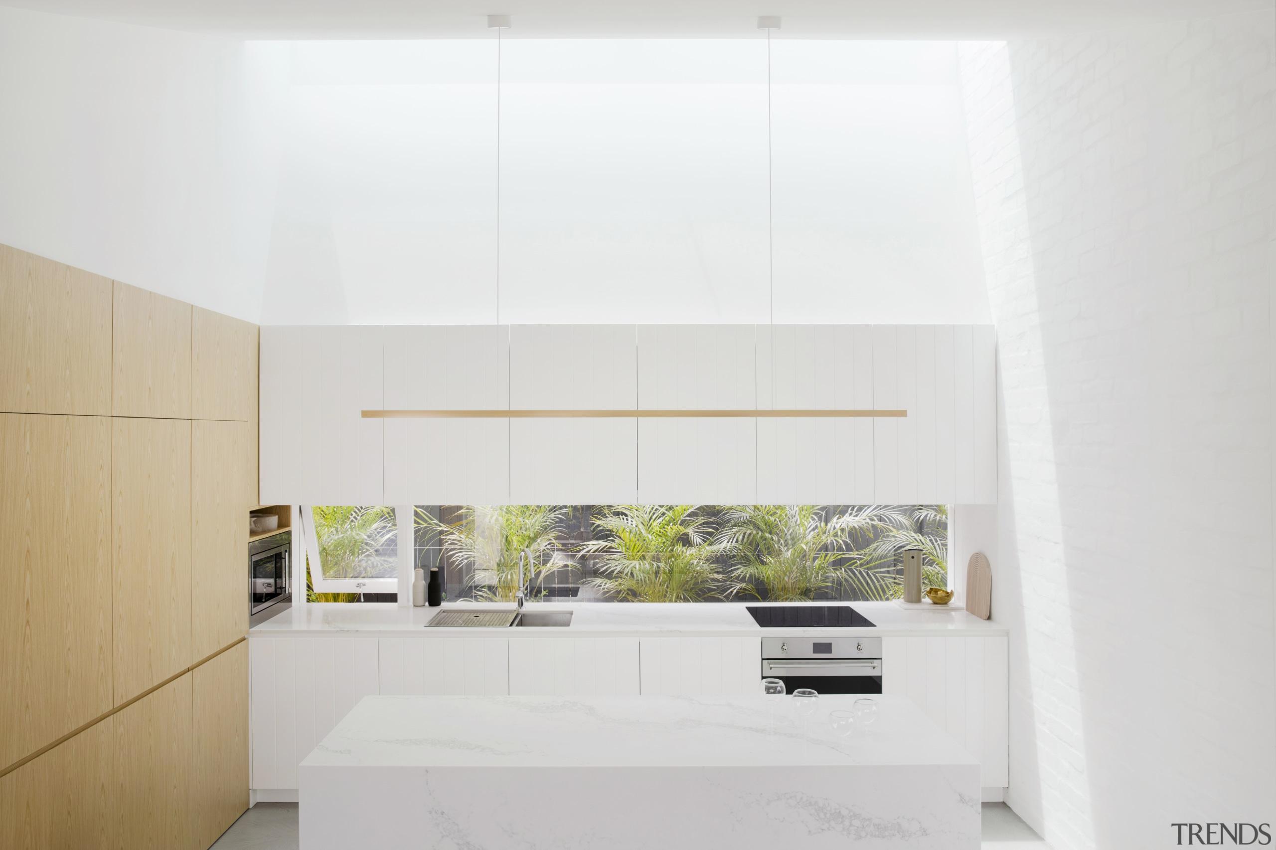 The small side window beside the glass splashback architecture, house, interior design, kitchen, white, kitchen island,  studio prineas