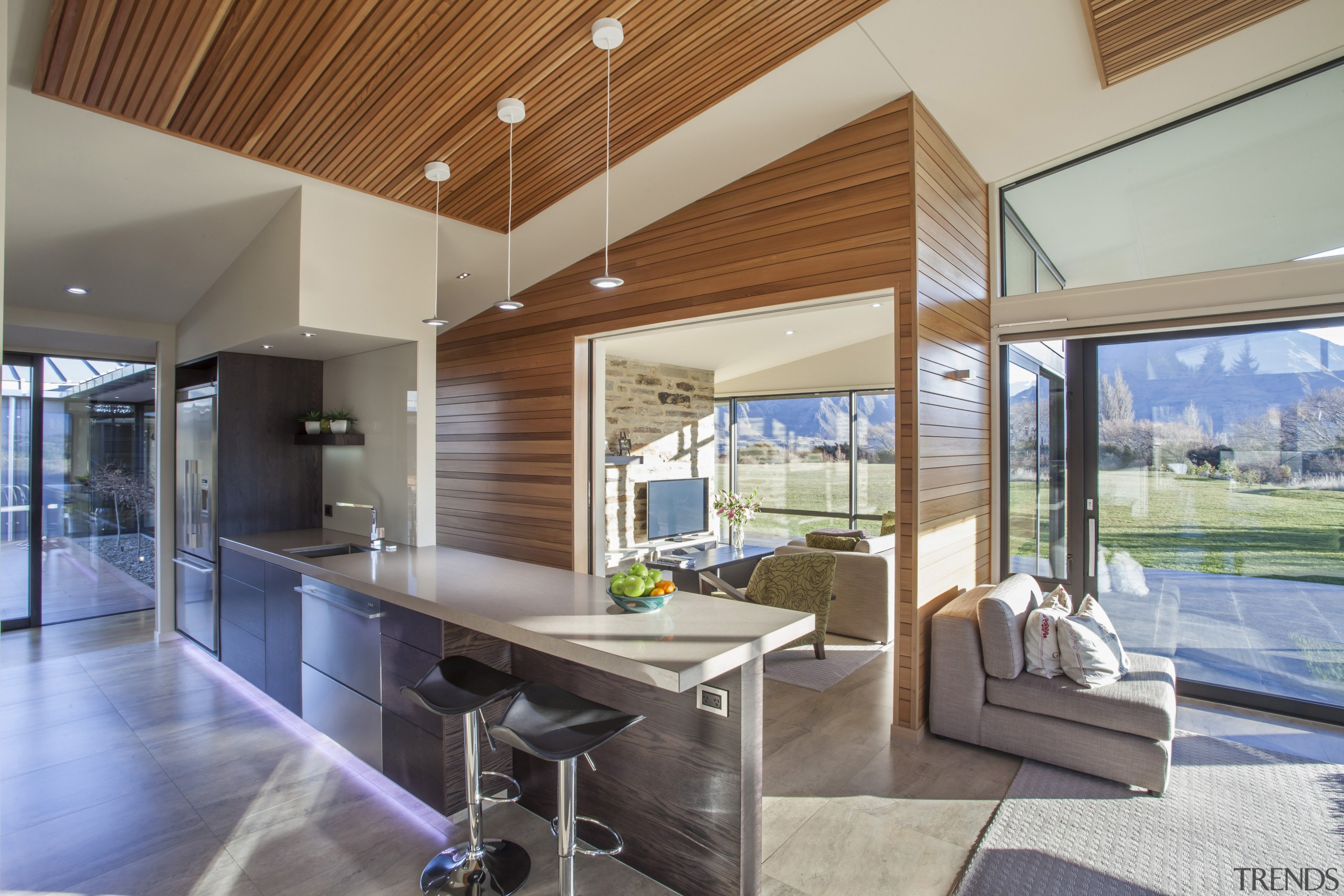 A timber veneer galley kitchen with scullery sits architecture, estate, house, interior design, real estate, window, gray