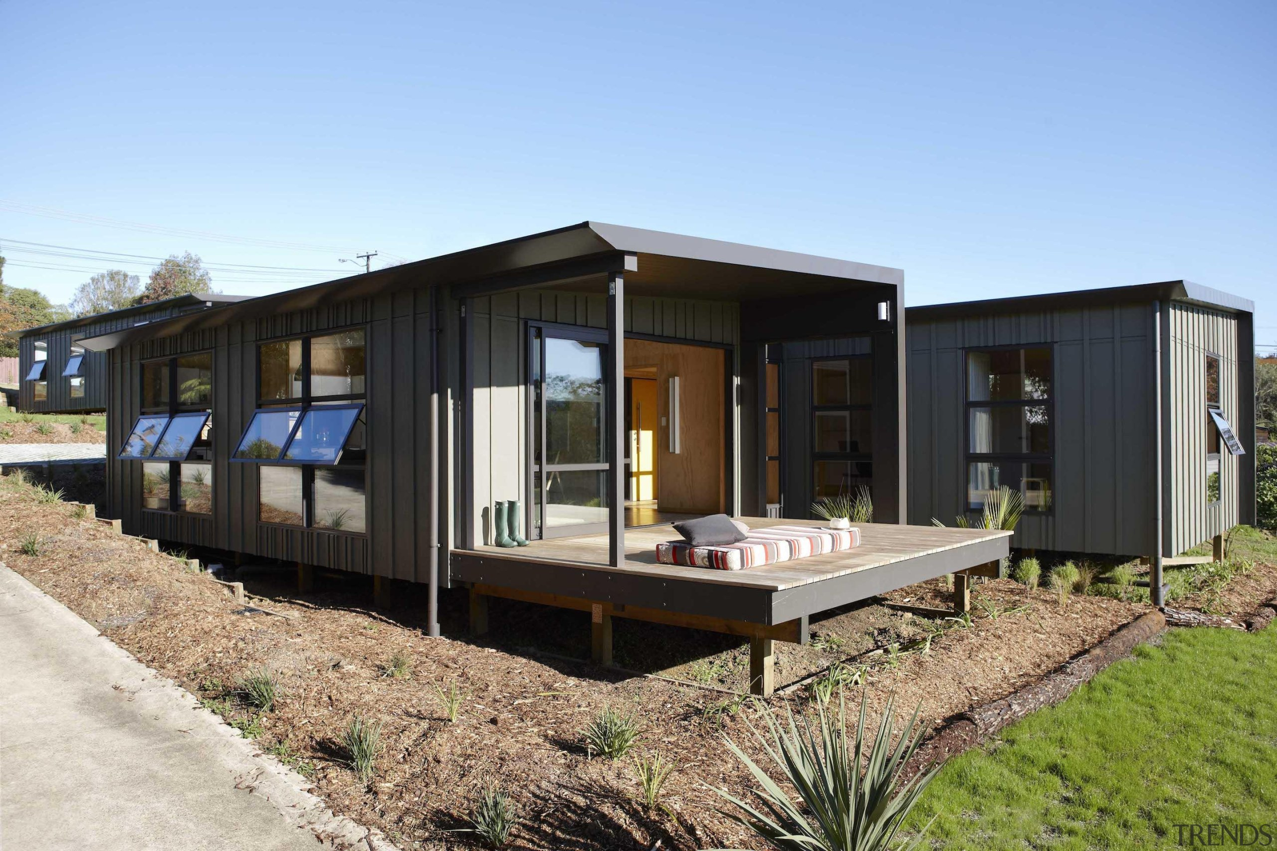 Waitakere Ranges - Studio 19 VisionWest Community Housing architecture, home, house, property, real estate, teal, black
