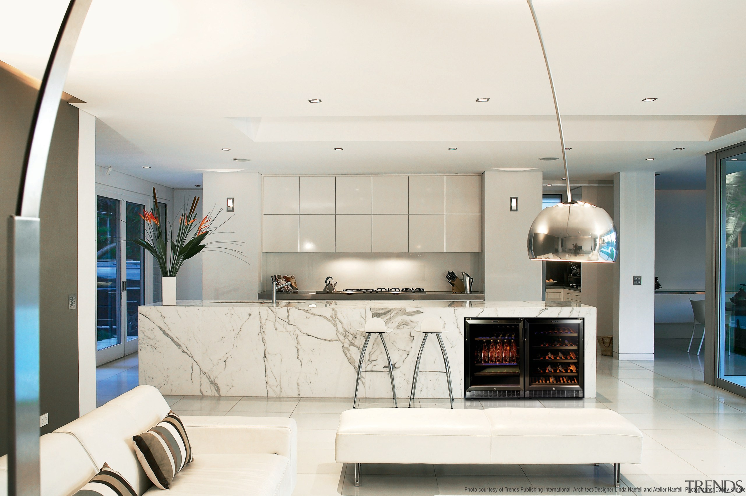 View of a modern kitchen which features a interior design, living room, real estate, white