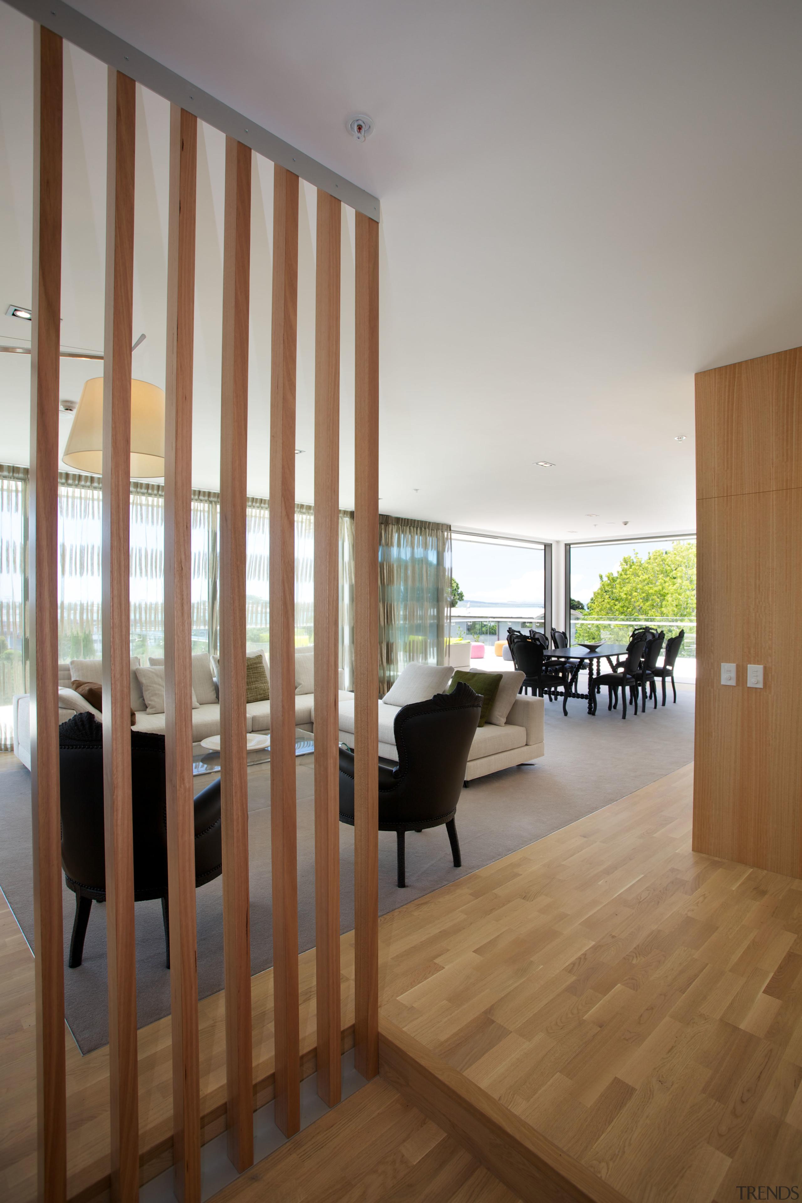 Tall timber slats define the entry to this apartment, architecture, daylighting, door, floor, flooring, hardwood, house, interior design, laminate flooring, wall, window, wood, wood flooring, brown, gray