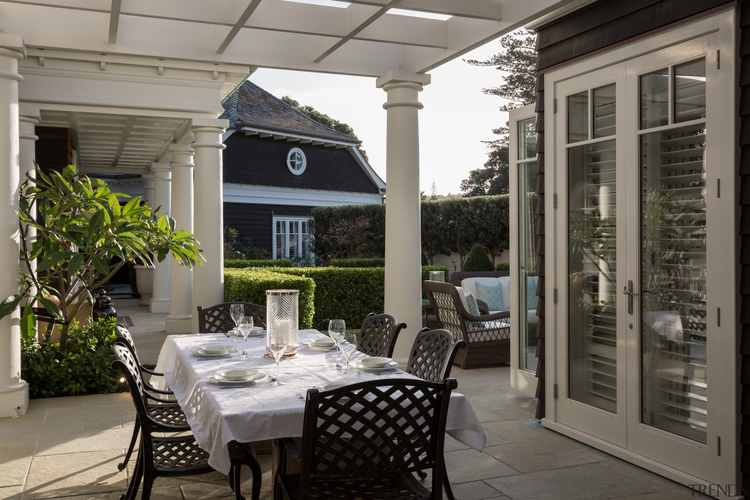 On this coastal home, a loggia is tucked dining room, home, interior design, outdoor structure, patio, porch, real estate, window, gray, black