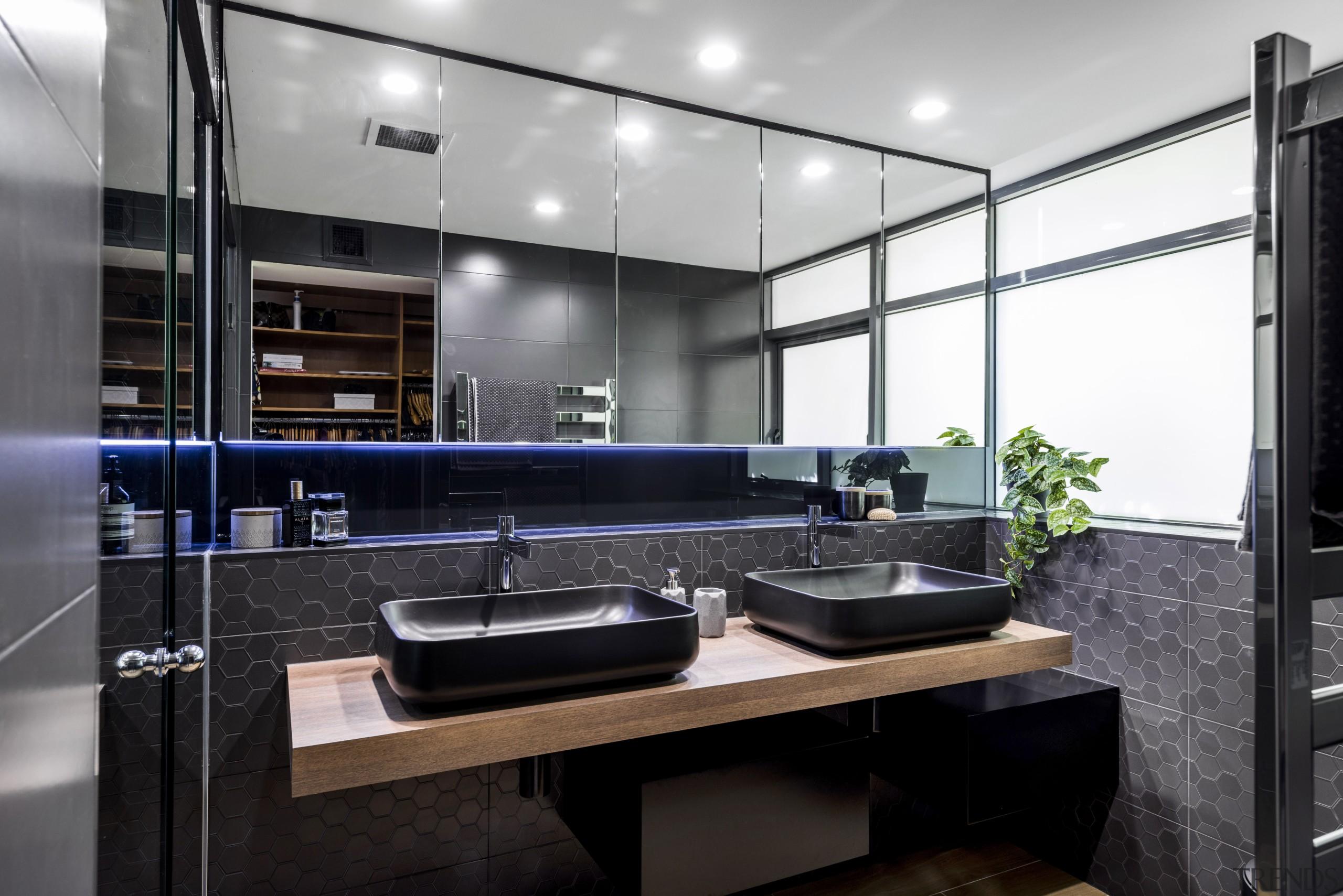 Multi-purpose feature  in this apartment ensuite a countertop, interior design, kitchen, black, white