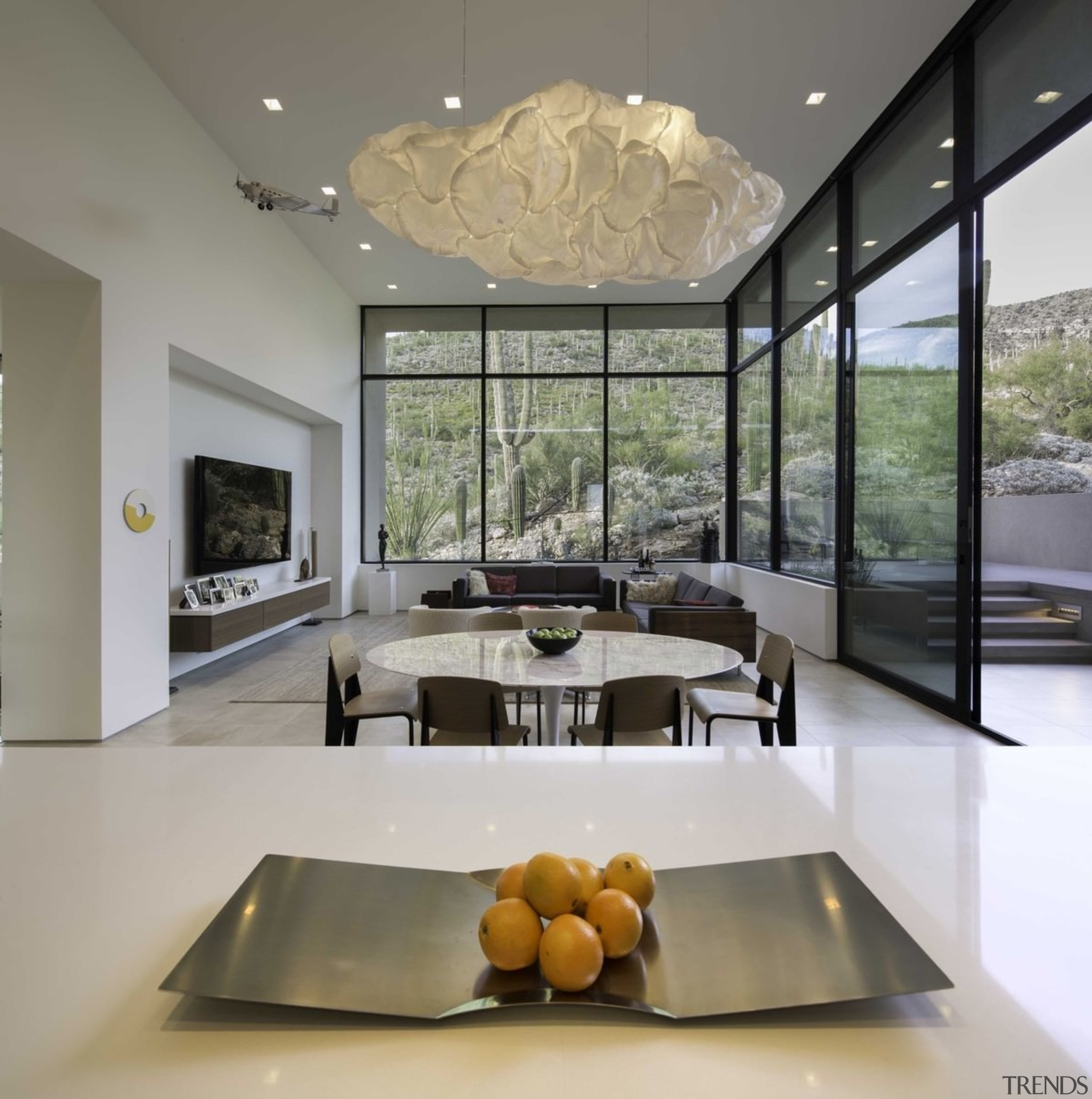 A cloud-like light hangs above this informal dining architecture, ceiling, house, interior design, living room, gray