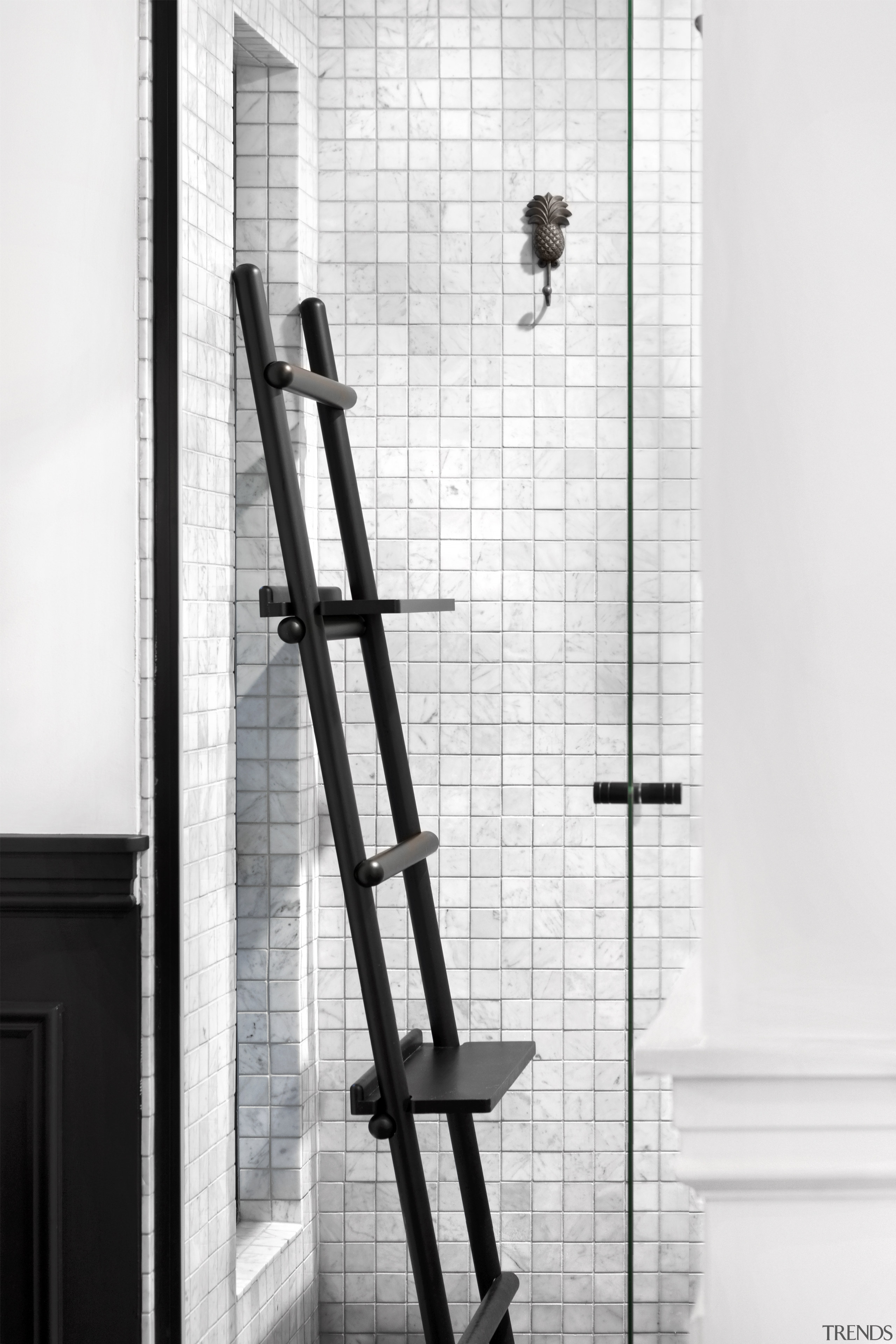 This quirky shower stall inclusion has a 'found' black and white, ladder, structure, window, white