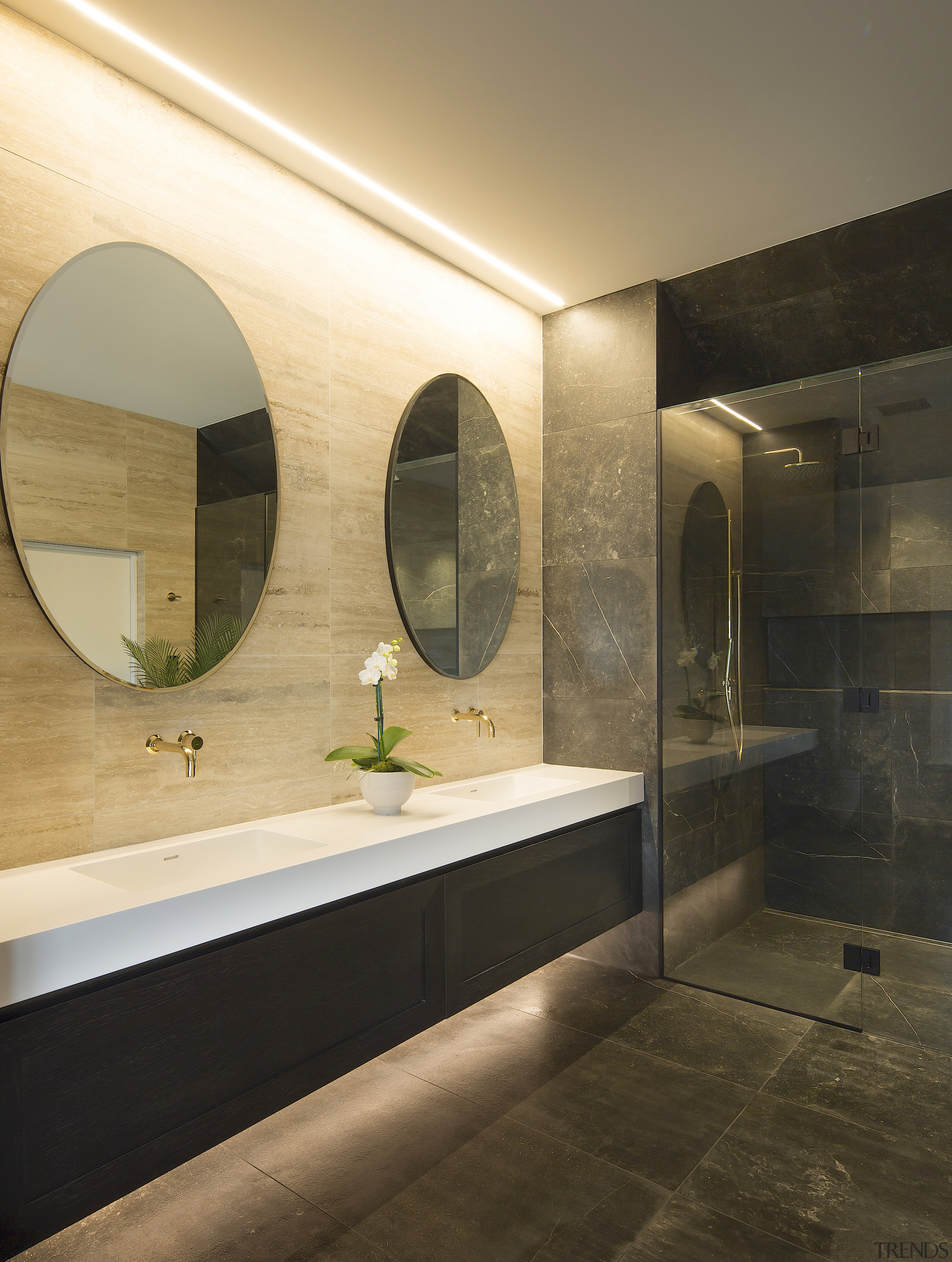 The long suspended vanity adds to the bathroom's